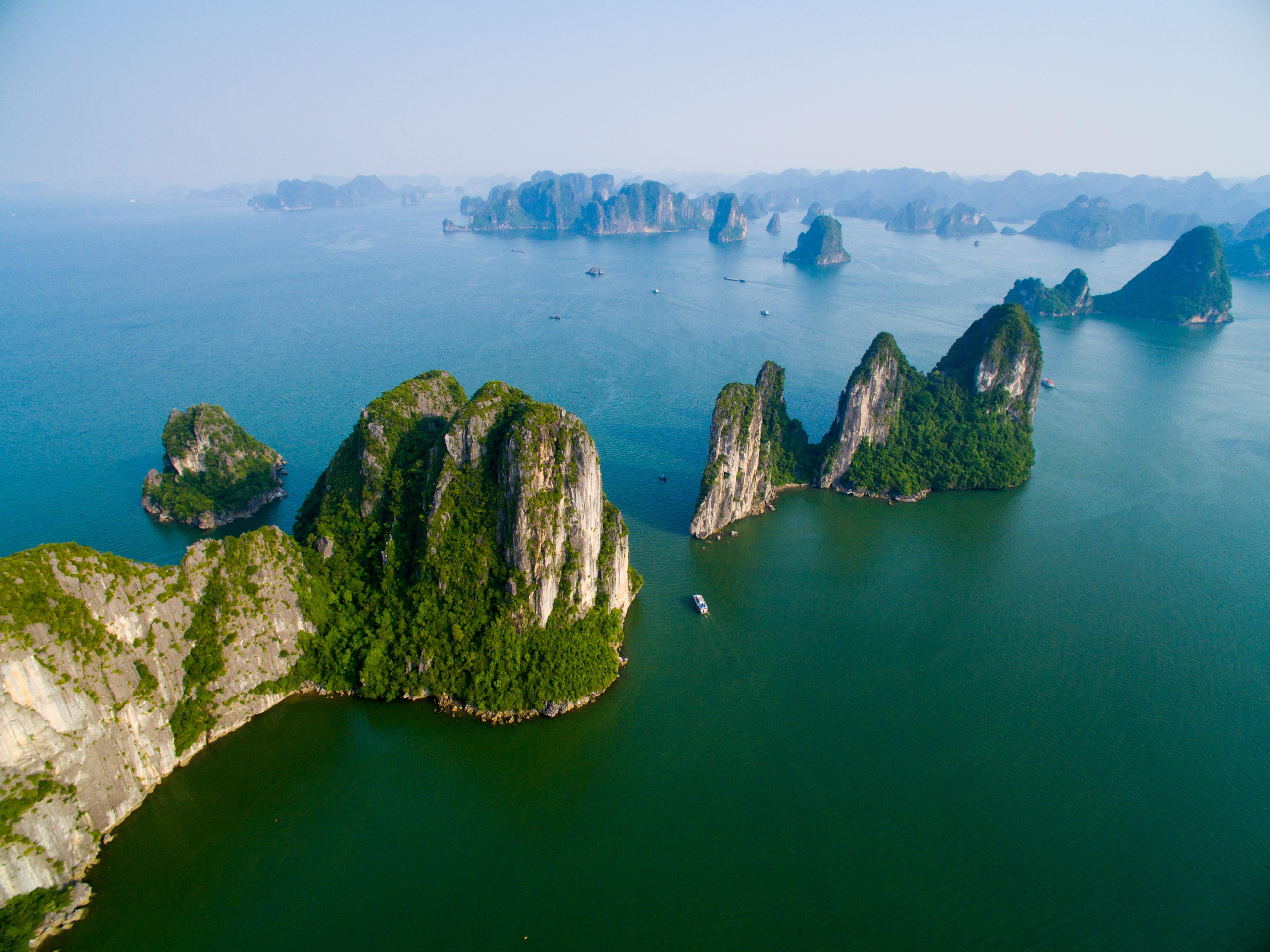 Slide 21 of 51: Ha Long Bay's natural beauty makes itone of Vietnam's number one tourist sites. The bay is alsoaUNESCO World Heritage site.The best way to see Ha Long's awe-inspiring limestone towers is by boat. In fact, many tourists stay overnight on a boat in the bay.