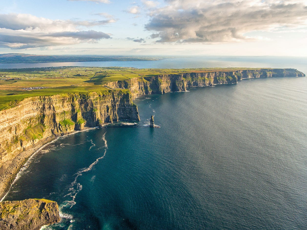 Slide 31 of 51: One of Ireland's most-visited natural attractions, the Cliffs of Moher stretch along the country's west coast for five majestic miles. The rugged cliffs offer unparalleled views of the ocean below.