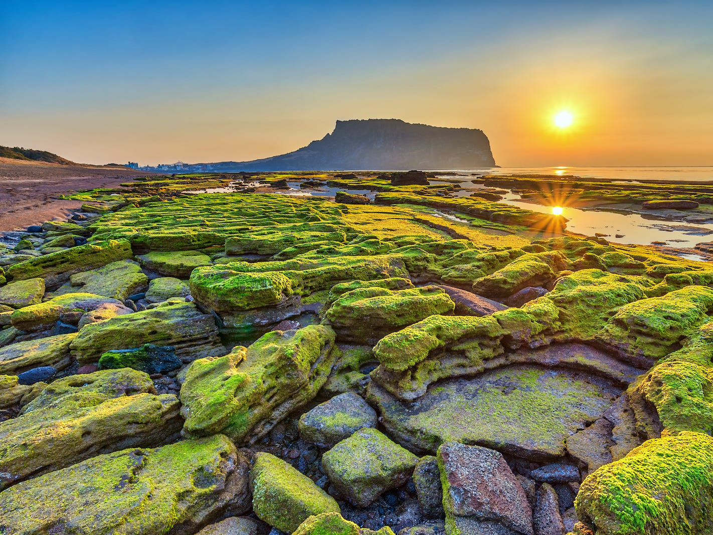 Slide 44 of 51: Jeju Island boasts South Korea's highest mountain, Hallasan, a dormant volcano that towers nearly 6,400 feet above sea level.The island is also known for its spectacular lava tubes (caves formed by cooling lava).