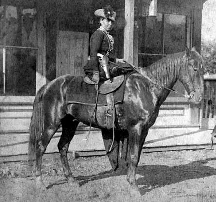 Slide 9 of 32: Myra Maybelle Shirley Reed Starr began associating with outlaws in her late teenage years, including with the likes of Jesse James. She developed a reputation as a horse thief and a crack shot. She also nurtured a strong sense of fashion and was often seen riding sidesaddle while elegantly dressed in black velvet. Starr was fatally shot while riding home from a neighbor's house in a case that is still officially unsolved.