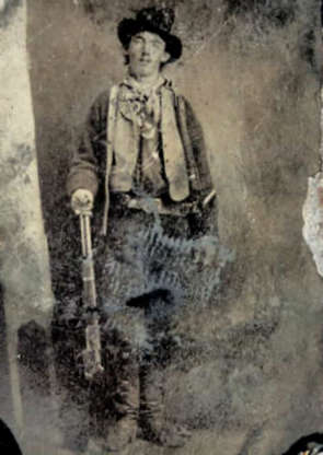 """Slide 2 of 32: """"Billy the Kid,"""" whose real name was Henry McCarty, was also known by the pseudonym William H. Bonney. One of the most notorious figures of the American Old West, McCarty killed eight men before he was shot and killed at the age of 21. Billy the Kid's life and likeness have been frequently dramatized in Western popular culture. Pictured, an unretouched original image of Bonney, c.1880."""