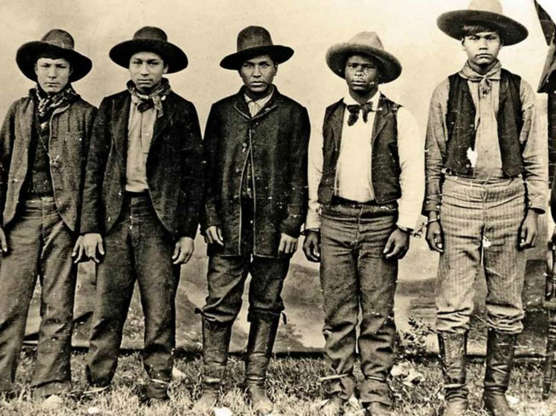 Slide 24 of 32: An outlaw multi-racial gang whose members were part African American and part Muscogee, the Rufus Buck Gang were responsible for a spree of killings and robberies committed from 1895 to 1896 across the Indian Territory of the Arkansas-Oklahoma area. Exceptionally brutal and indiscriminate in their attacks, the gang was eventually captured and all members hanged for their crimes. Pictured left to right: Maoma July, Sam Samson, Rufus Buck, Lucky Davis, and Lewis Davis.