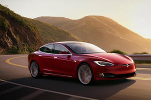a car parked on the side of a mountain: Tesla Model S. Cars.com
