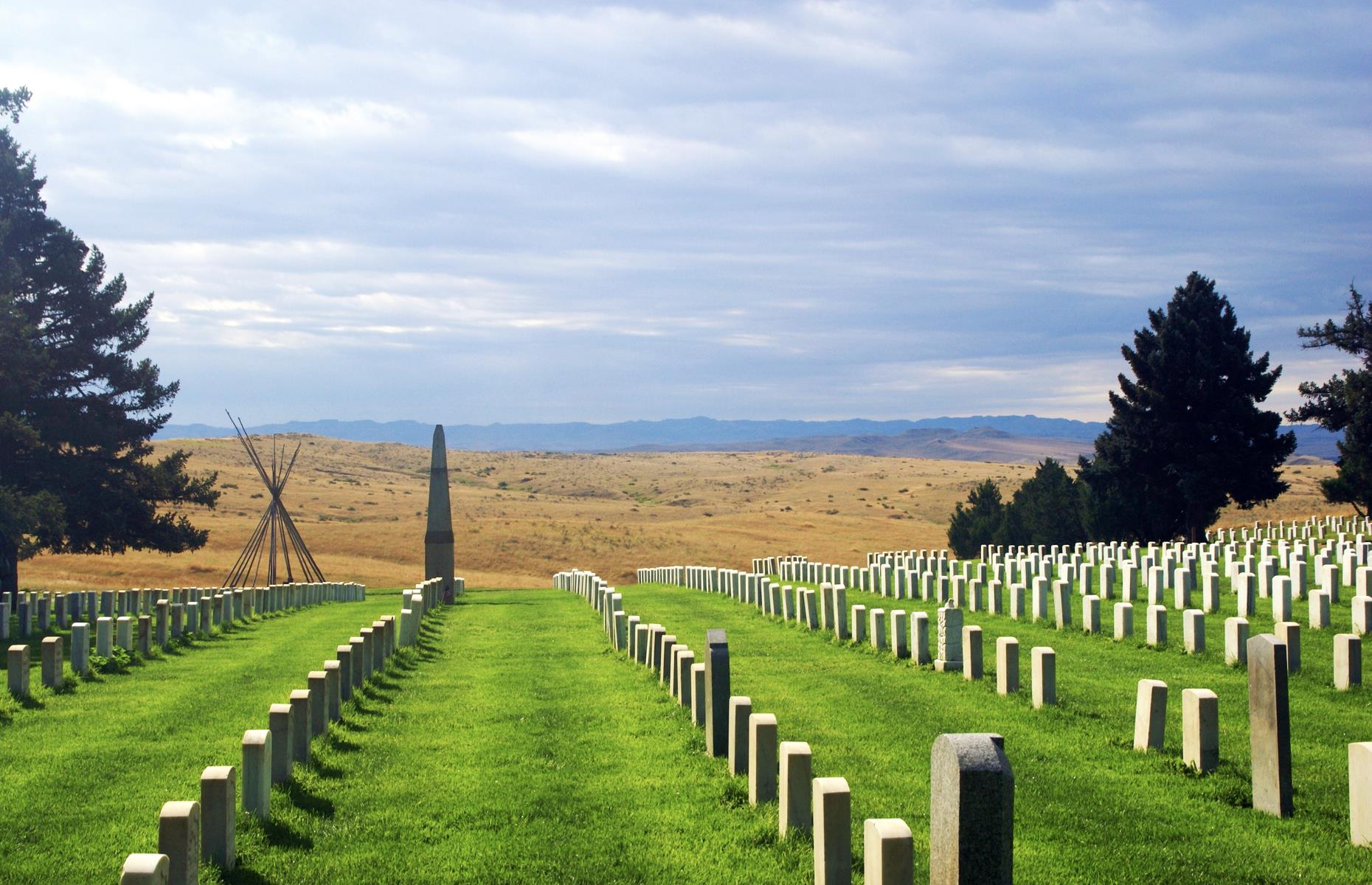 "Slide 29 of 51: This site commemorates ""Custer's Last Stand"", an 1876 battle between US troops and the Lakota Sioux, Arapaho and Northern Cheyenne tribes. As part of an ongoing campaign, the United States attempted to seize land belonging to these peoples. The Americans were defeated this time, representing a single victory for the indigenous people. Today, a granite memorial and acres of gravestones honor the thousands who died here. The Spirit Warrior Sculpture specifically marks the sacrifices made by the indigenous peoples."