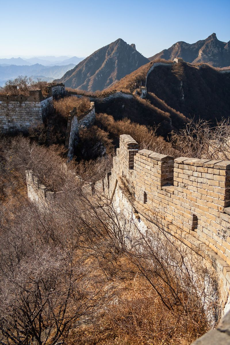 Slide 38 of 38: Due to its immense size and cost of upkeep, parts of the Great Wall of China have fallen into disrepair. Wild overgrowths now fill the walkways with thick shrubs, grass, and weeds.