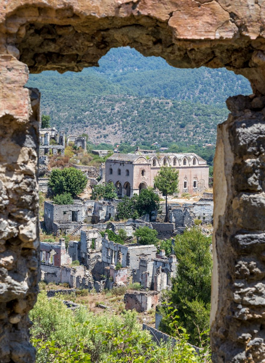 Slide 22 of 38: This town nestled in the Taurus Mountains was deserted in the 1920s because of a political population exchange with Greece. Today, there are around 350 abandoned homes in the city.
