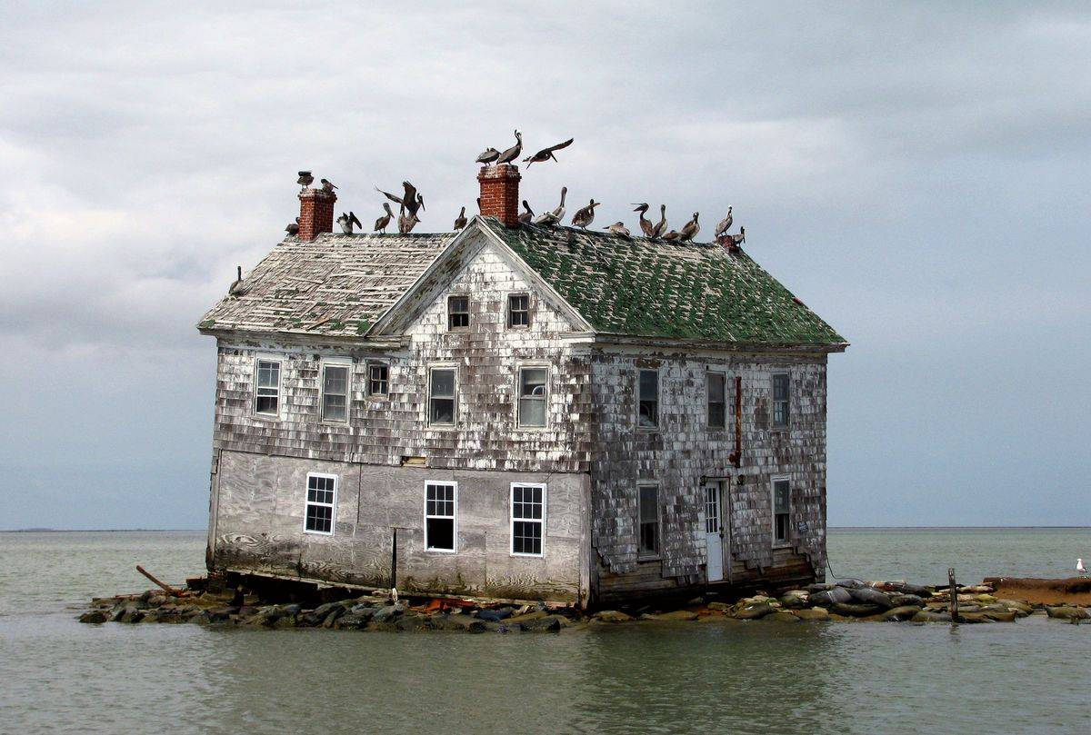 Slide 34 of 38: This house was all that's left of what was once a small island colony in the Chesapeake Bay. Thanks to erosion of the island's coast, inhabitants were pushed off the island. This house ultimately collapsed as well in 2010.