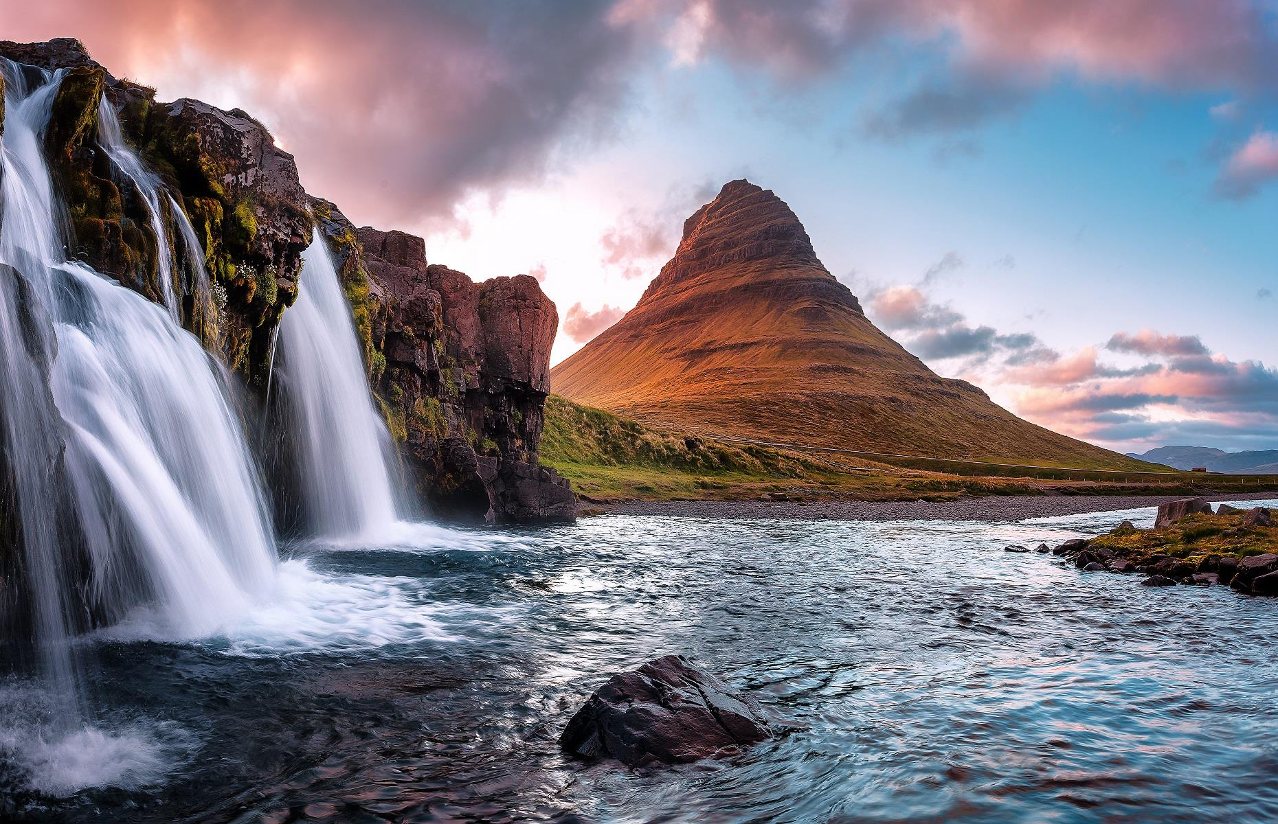 Slide 3 of 59: We've all heard of Everest and Fuji, and while these peaks are mesmerizing in their own ways, Kirkjufell in Iceland is altogether more ethereal. The 1,519-foot (463m) mountain can be found on the island's western coastline, an area defined by crystalline fjords, geothermal pools and dynamic waterfalls. It's the most photographed peak in all of Iceland and was also used as Arrow Head Mountain in the TV series Game of Thrones.