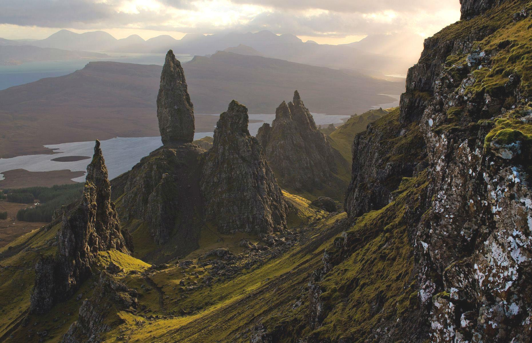 Slide 19 of 59: Perched around 2,300 feet (700m) up on Trotternish Ridge, The Old Man Of Storr is one of Scotland's most recognizable natural landmarks. Characterized by its towering rocky pinnacles, this theatrical monument is shrouded by folklore tales. Legend has it the Old Man was a giant, who upon being buried in the earth, left his thumb exposed.