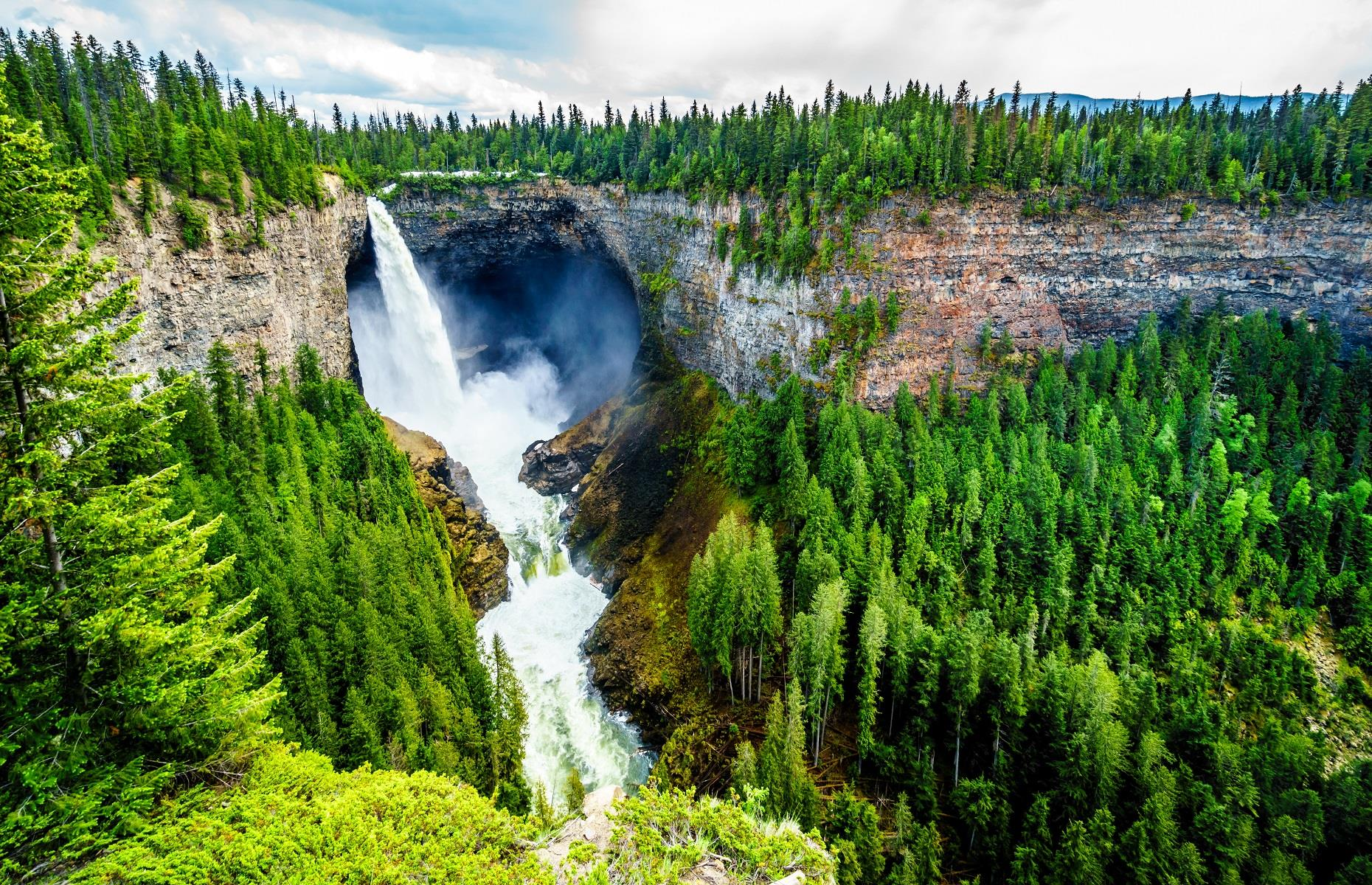 Slide 20 of 59: Here to prove that not all waterfalls were made equal, the Helmcken Falls in British Columbia is a sight to behold. Positioned on the Murtle River within Wells Gray Provincial Park, this 462-foot (141m) wonder was discovered in 1913 by Robert Henry Lee. Helmcken is by far one of the most scenic spots in all of North America and visitors can enjoy panoramic views of the titan from a viewing platform on the rim of the canyon.