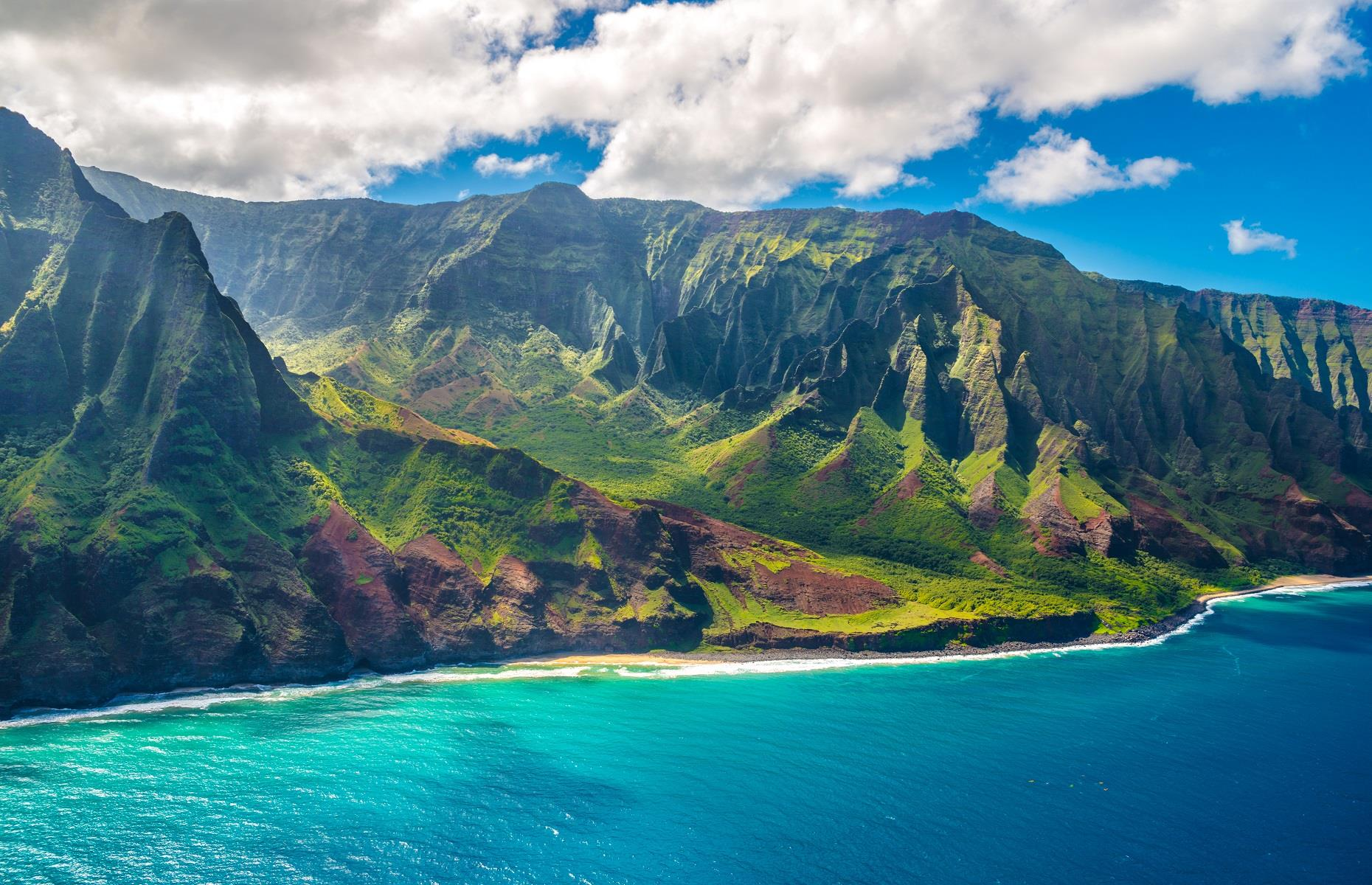 Slide 37 of 59: We're not sure about you but we've never seen anything more incredible than the Nā Pali Coast in Hawaii. This dazzling shoreline is punctuated by razor-sharp sea cliffs, delicate winding valleys and cascading waterfalls. The eye-catching area has had a silver screen moment too – it was the backdrop for 1997's The Lost World: Jurassic Park.