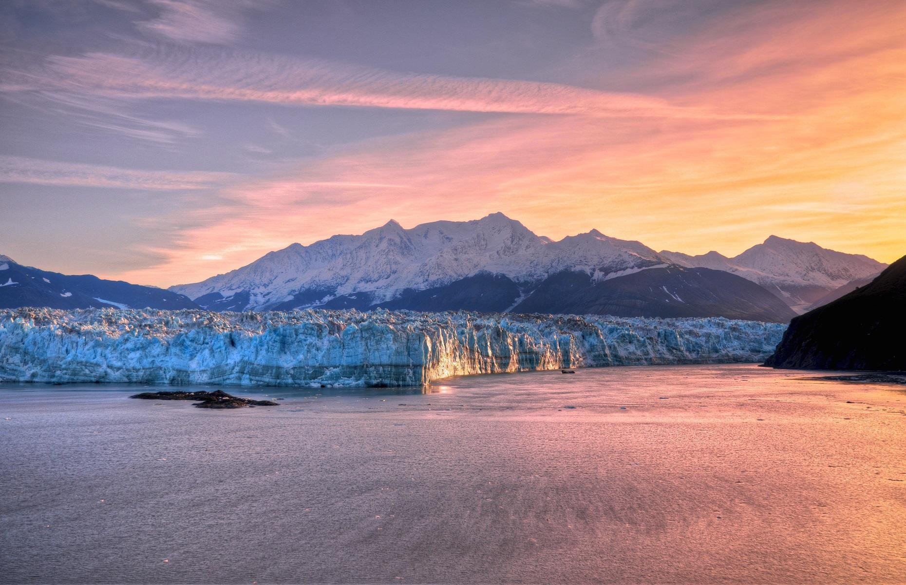 Slide 38 of 59: The Hubbard Glacier in Alaska sits peacefully off the coast of Yakutat. Its majestic face stretches up to 400 feet (122m) tall and six miles (9.6km) wide. Most of the ice is below water but what you can see is still incredibly impressive. Cruise ships aren't allowed to get too close as the ice can be very thick.