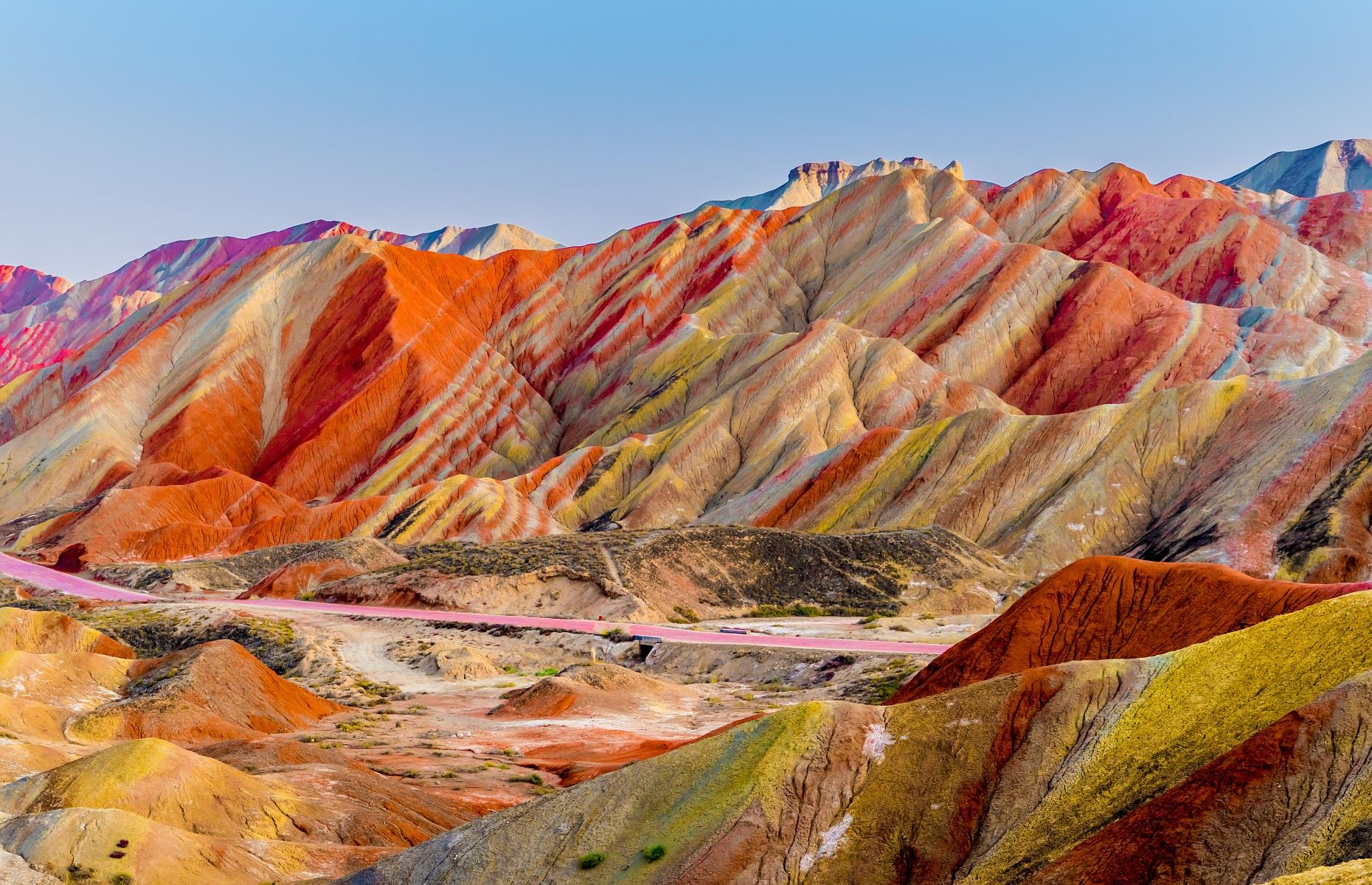 Slide 22 of 59: The rainbow-hued mountains in Zhangye National Geopark looks just like an artist's paint palette. Part of an UNESCO World Heritage Site, this stunning formation was created by natural erosion, when layers of sand, silt, iron and minerals blended together to create a kaleidoscope of colors. The incredible park appears to have been decorated by Mother Nature herself.