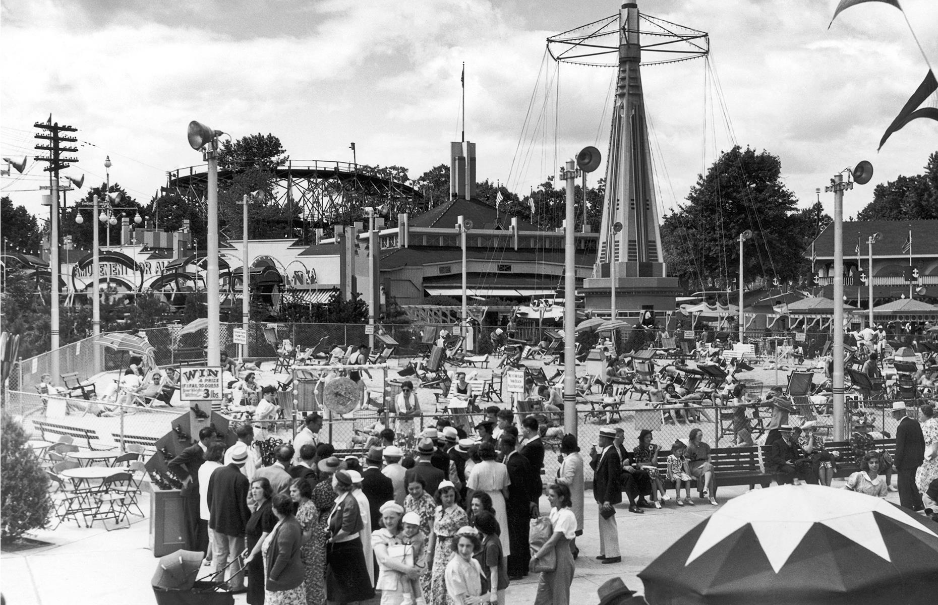 Slide 20 of 31: A stretch of sand and plenty of rides and roller coasters pulled visitors in to Palisades, a kitsch amusement park in New Jersey. It operated from the late 1890s right up until the 1970s. This nostalgic snap shows pleasure seekers milling about beneath the rides and on the little beach circa 1947. Check out more historic photos of theme parks in their heyday.