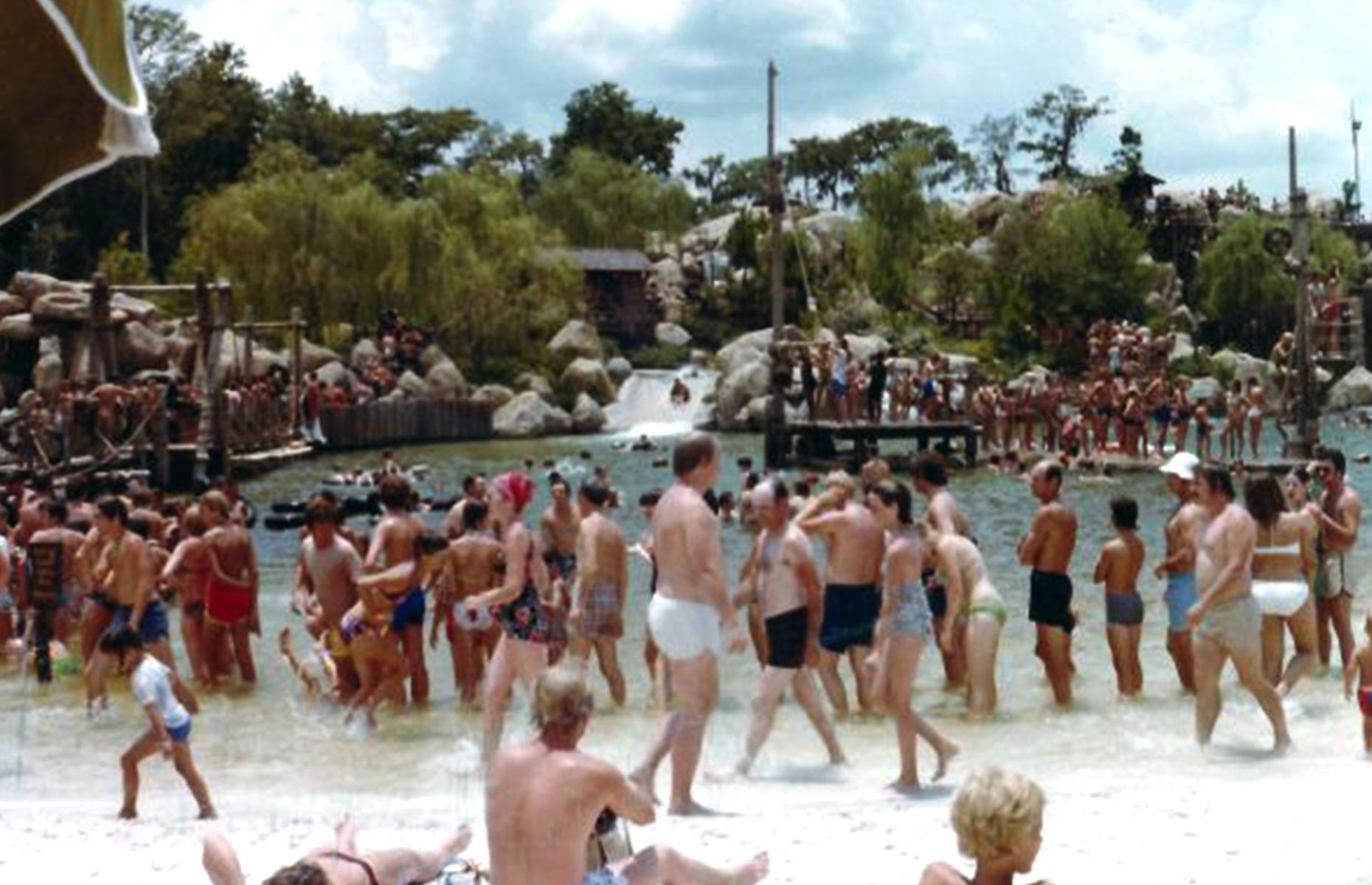 Slide 22 of 31: The creepy remains of Disney's River County still exist in Florida's Bay Lake (pictured here in 1977). Walt Disney World Resort's earliest water park opened in 1976, drawing visitors in their thousands with its slides rushing over rocks and its large swimming hole. The park was well-loved over the decades, but a handful of tragedies were linked to the site: two children died from drowning in the 1980s and another from a fatal amoebic infection contracted from the water.