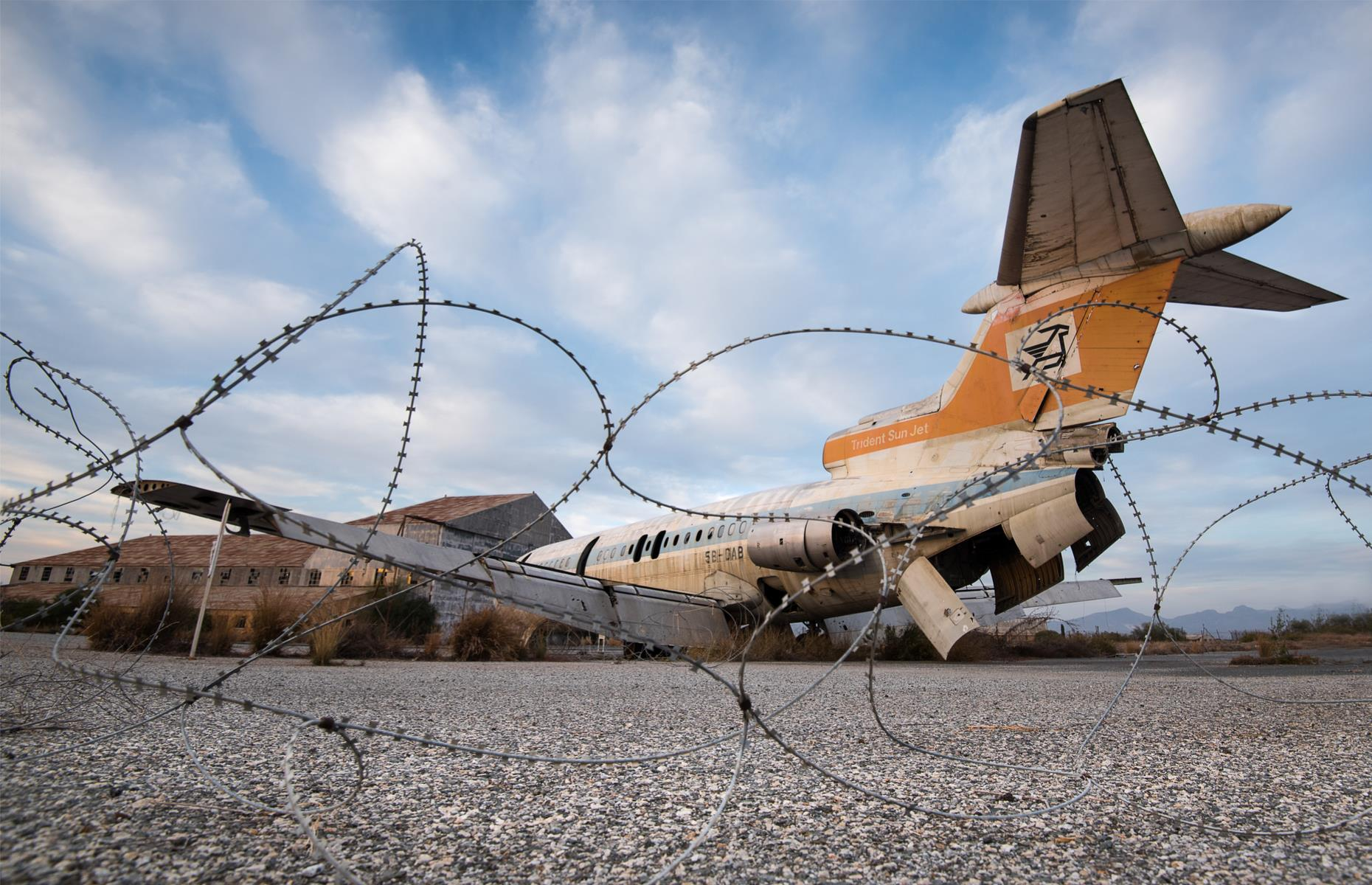 Slide 36 of 51: Abandoned houses, shops and even an airport remain untouched and crumbling reminders of a bygone era. At the derelict Nicosia International Airport, a destroyed Cyprus Airways jet still stands near the runway. Take a look at more airports that were built then abandoned.