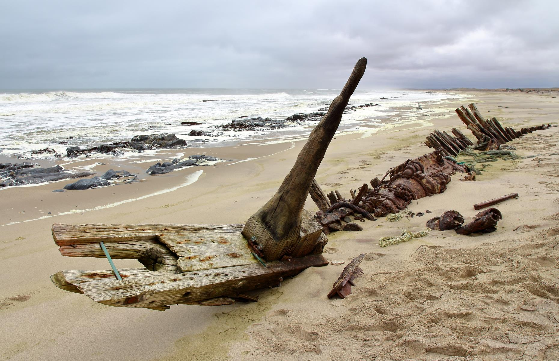 Slide 15 of 51: The old wrecks are reminders of how many shipwrecked sailors have lost their lives to the coast. Once stranded, the only way out was by walking hundreds of miles through a hot and arid desert – and it was impossible to survive.