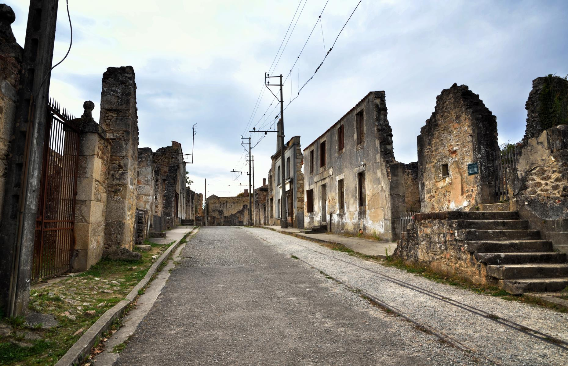 Slide 41 of 51: Since its destruction by the Nazis during the Second World War, this site in central France has been left untouched as a gut-wrenching reminder. On 10 June 1944, 642 inhabitants of the village Oradour-sur-Glane were shot or burned alive by the German forces.
