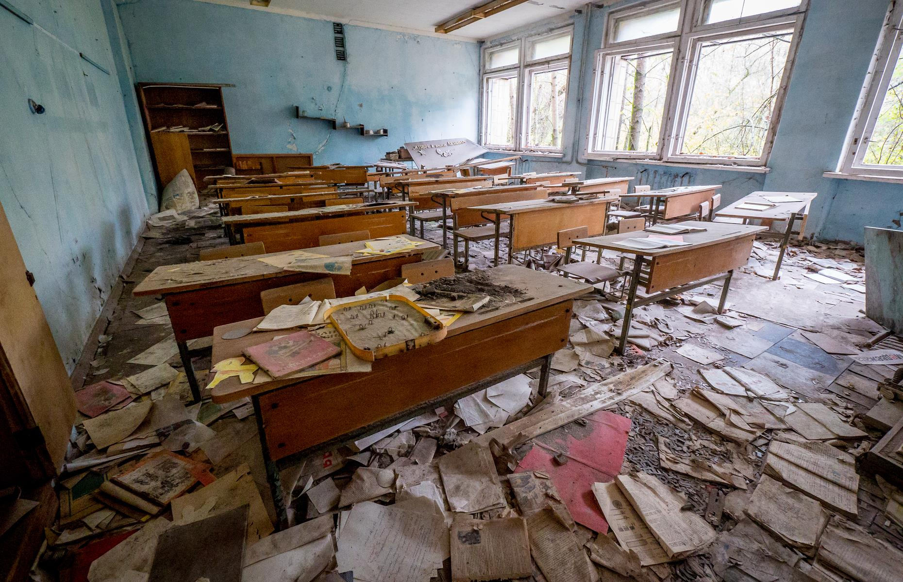 Slide 47 of 51: In the deserted school near the Chernobyl power plant, books and paper are scattered on the floor of the classrooms. Inhabitants of the evacuated area had to leave everything behind due to the radiation. More than 30 years on it leaves visitors with an eerie feeling.