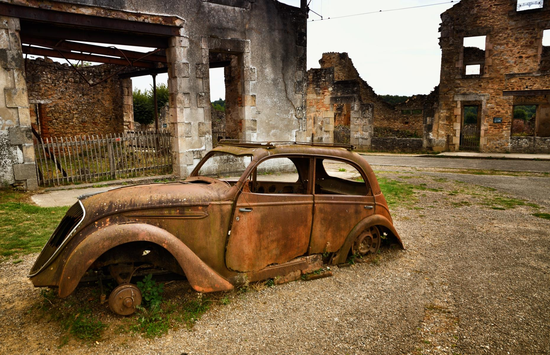 Slide 42 of 51: Three-quarters of a century later, the ghost town is a memorial to those who perished. Rusted cars, including the Peugeot 202 the mayor drove before his brutal death, still sit on the roads. Discover the incredible pictures of tourist attractions that no longer exist.
