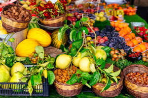 a group of fruit and vegetable stand: Variation of fresh fruits and vegetables on market stall at Campo di Fiori market in Rome, Italy