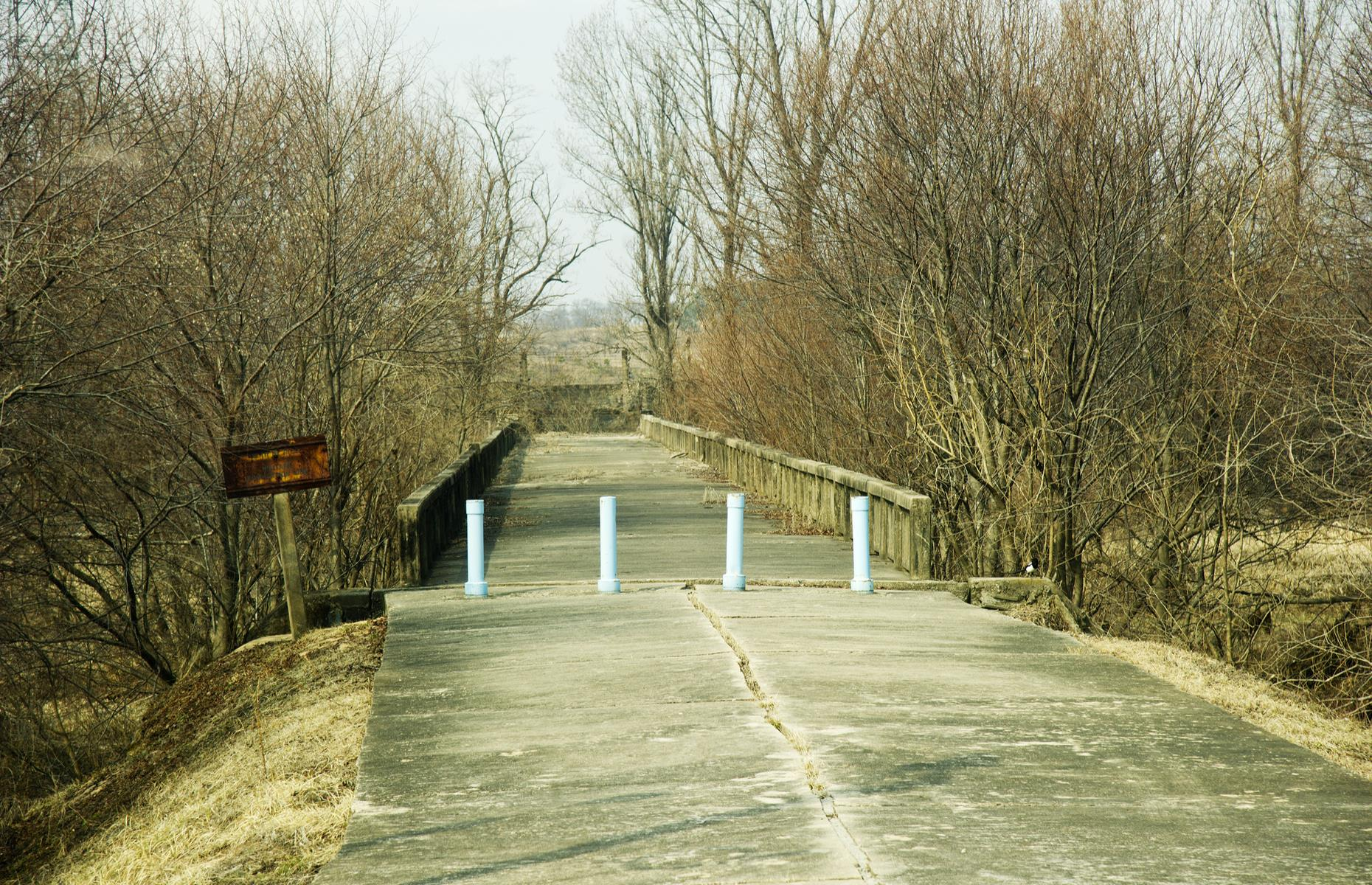 "Slide 6 of 51: This bridge in the DMZ has been untouched for decades and was used for prisoner exchanges until 1968. Dubbed the ""Bridge of No Return"", war prisoners were given an ultimatum to either remain in the country of captivity or cross the bridge to return to their homeland. Once across the bridge, however, there was no return allowed."