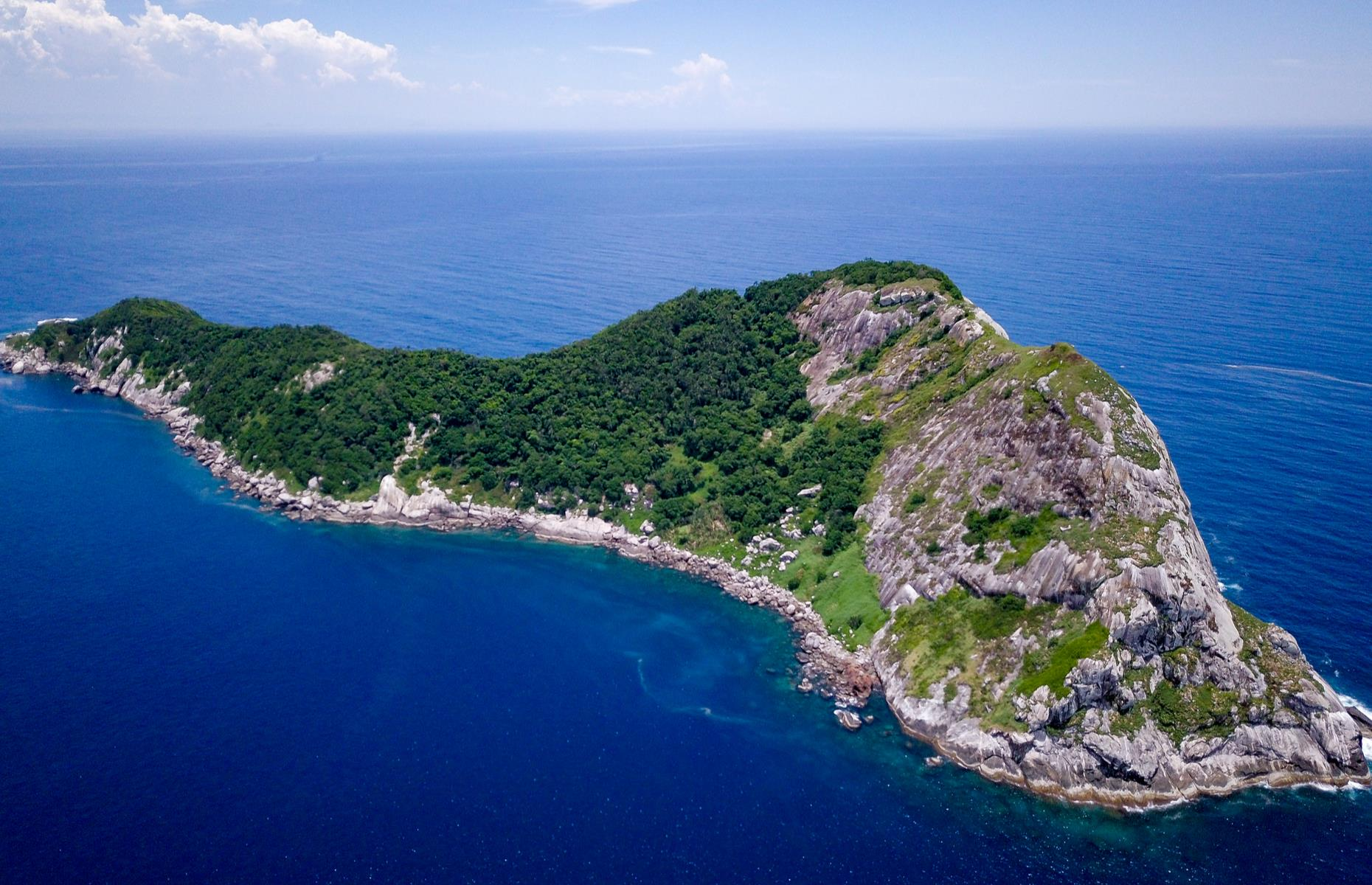 Slide 23 of 51: At first glance, this island off the coast of Brazil seems like the perfect escape with its crystal blue waters, lush vegetation and rocky expanse. However, there is a reason it's a no man's land...