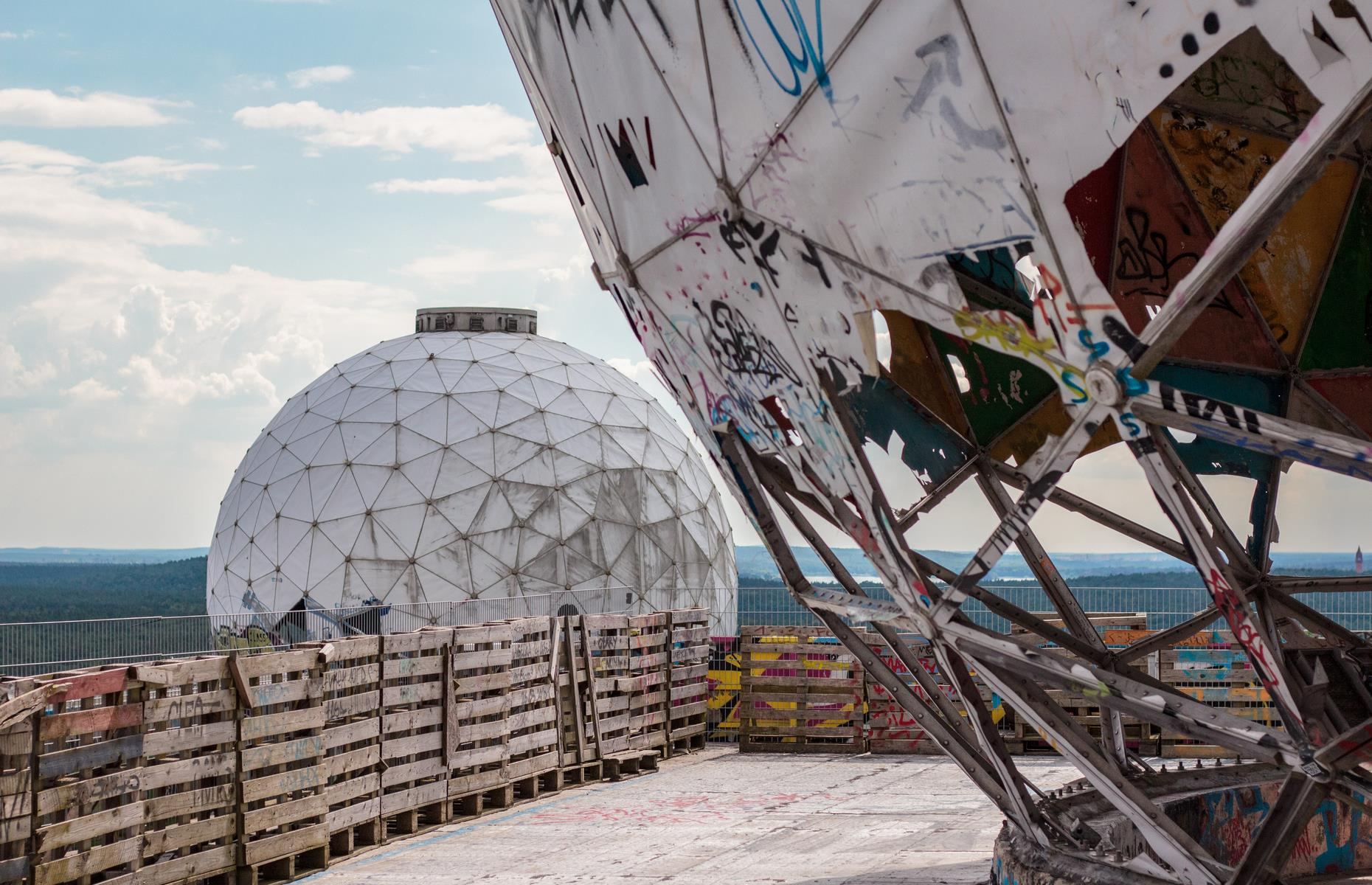 Slide 31 of 51: These derelict domes once formed the antenna of a listening station run by the USA's National Security Agency (NSA), in Berlin. Hidden on an artificial hill called Teufelsberg in the forested Grunewald, American agents used the station to spy on the Soviets during the Cold War. Since the late 1990s, when the site was left to decay, time seems to have stood still.