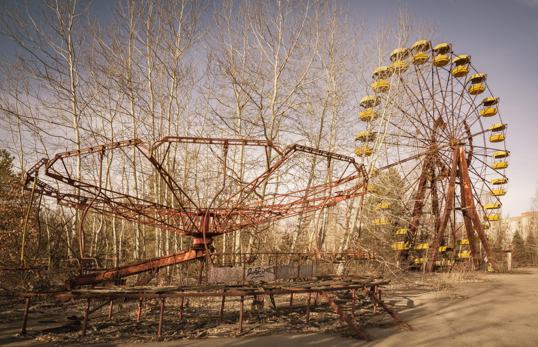 Slide 49 of 51: Today, its Ferris wheel, carousels and bumper cars are covered in rust and stand abandoned in the ghost town. Take a look inside America's abandoned theme parks here.