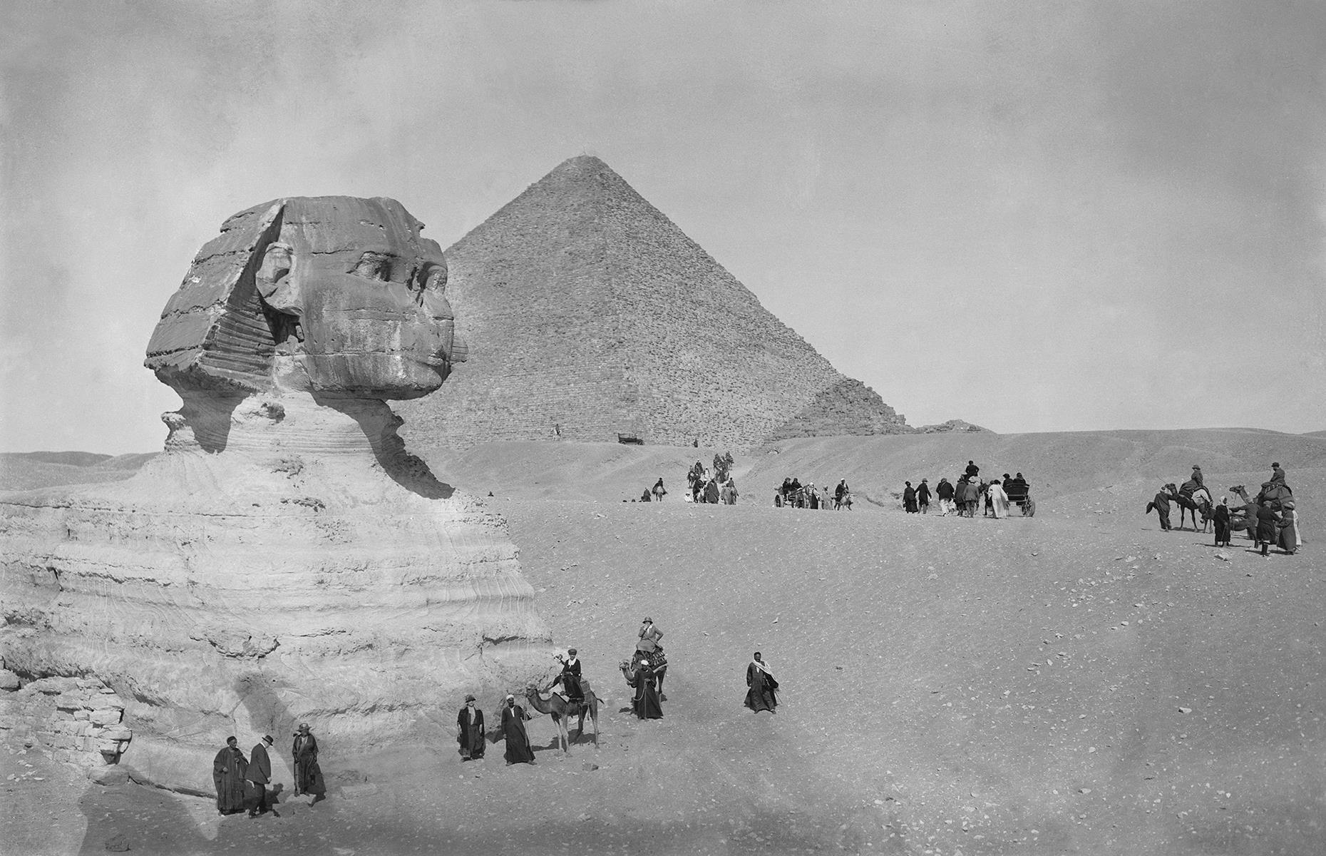 Slide 20 of 35: Beyond their decks and lavish lounges, cruises gave wealthy passengers the opportunity to explore far-flung destinations on organized excursions. Here American tourists from the Cunard liner Scythia are pictured wandering the ancient Giza pyramid complex, near Cairo, Egypt in 1923.
