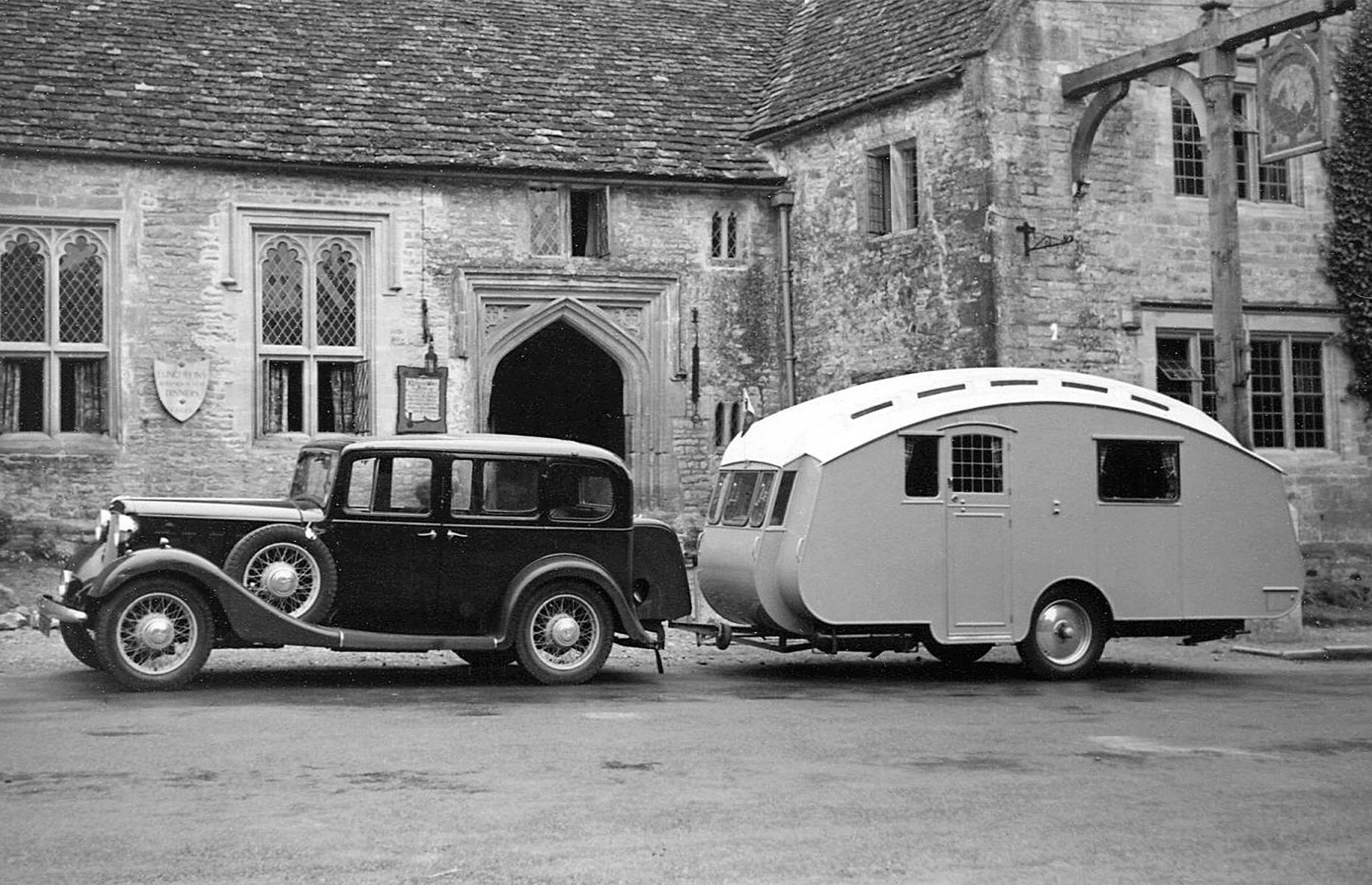 Slide 33 of 35: Motor-pulled caravans, which have pre-war roots, found their footing once the pandemic had ended too. In the 1930s, the gold standard of caravans was born with Bertram Hutchings' Winchester model (pictured), which was soon seen on roads and campsites across Britain. Unsurprisingly, caravan parks began to spring up along Britain's coastal areas too.