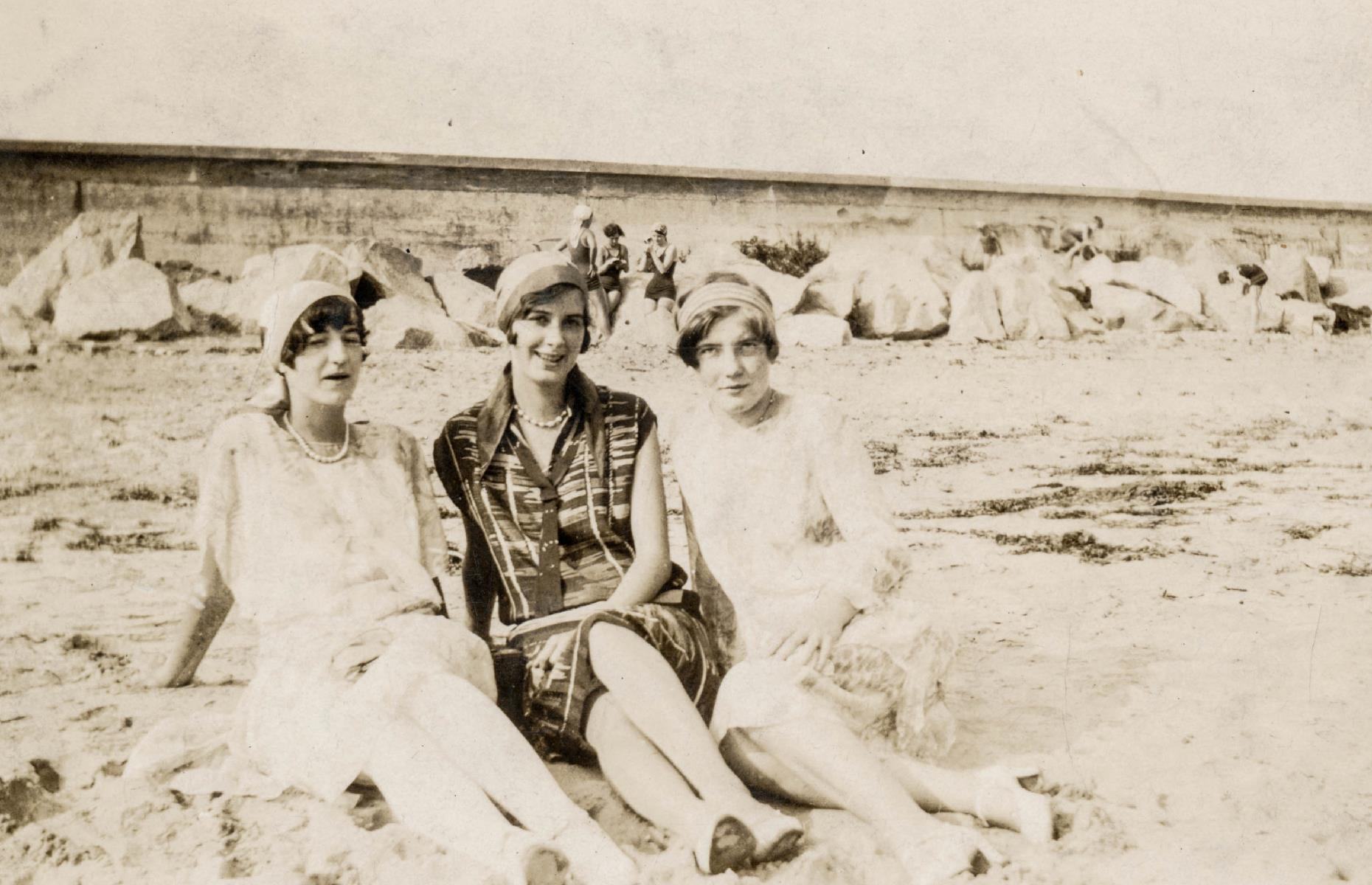 Slide 11 of 35: Despite the (perhaps surprising) appetite for post-war and post-pandemic travel, it remained the domain of the most privileged in society – and even they tended to stay close to home shores. Here three well-heeled, well-dressed women enjoy the sunshine on a beach in Massachusetts in the 1920s.