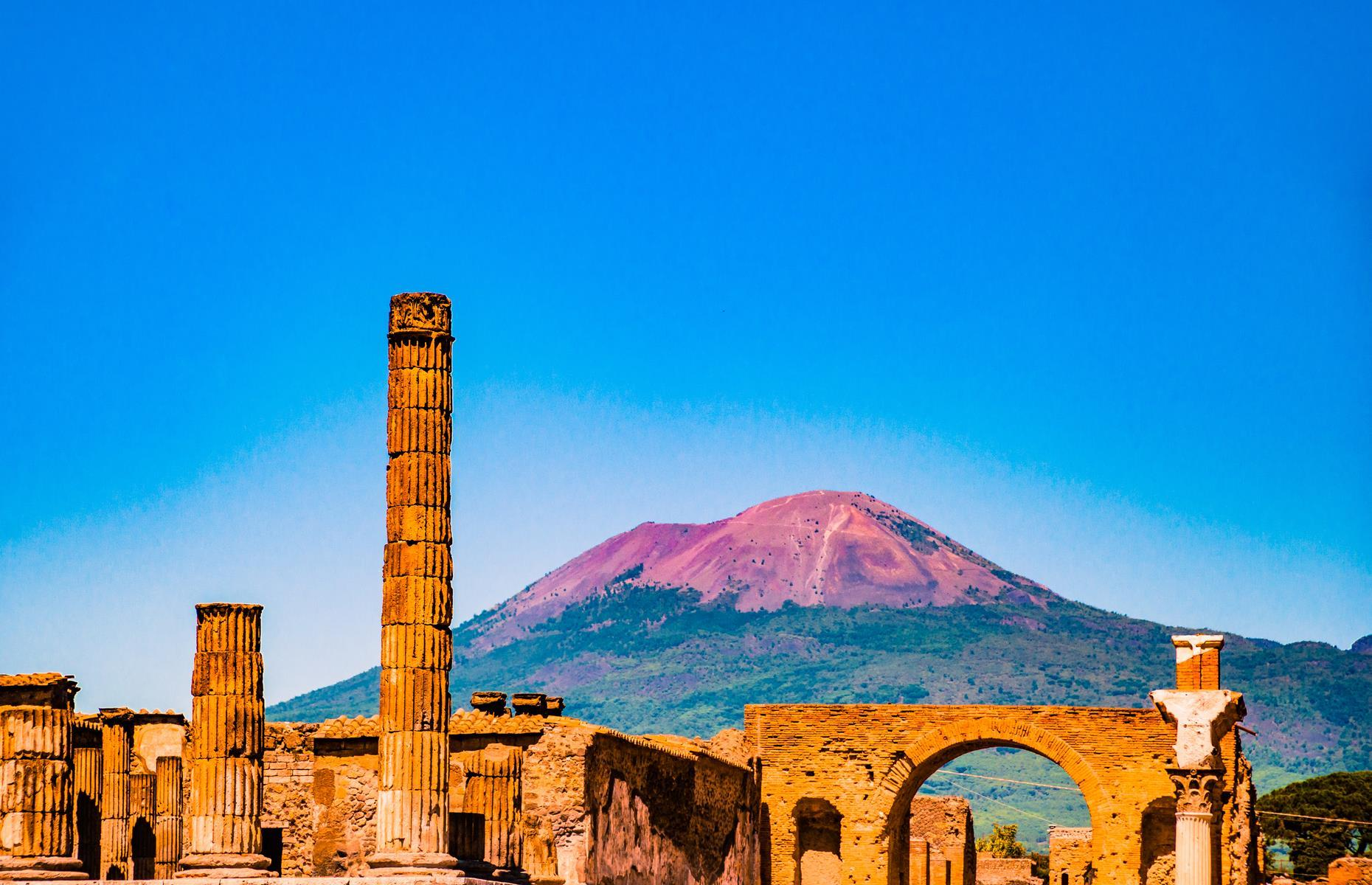 Slide 32 of 64: This Roman city in southern Italy was famously destroyed and buried beneath ash in AD 79 when Mount Vesuvius erupted spectacularly on 24 August. Around 2,000 people perished within the city and it remained buried under tons of ash, rock and pumice until its sprawling ruins were rediscovered in 1748. It's Europe's richest archaeological site.
