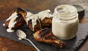 a piece of cake on a plate: It wouldn't be right to have a game day barbecue without Alabama's signature white barbecue sauce. This recipe pairs tangy regional barbecue sauce with smoky, tender chicken. For the White BBQ Sauce With Smoky Chicken recipe, click here.