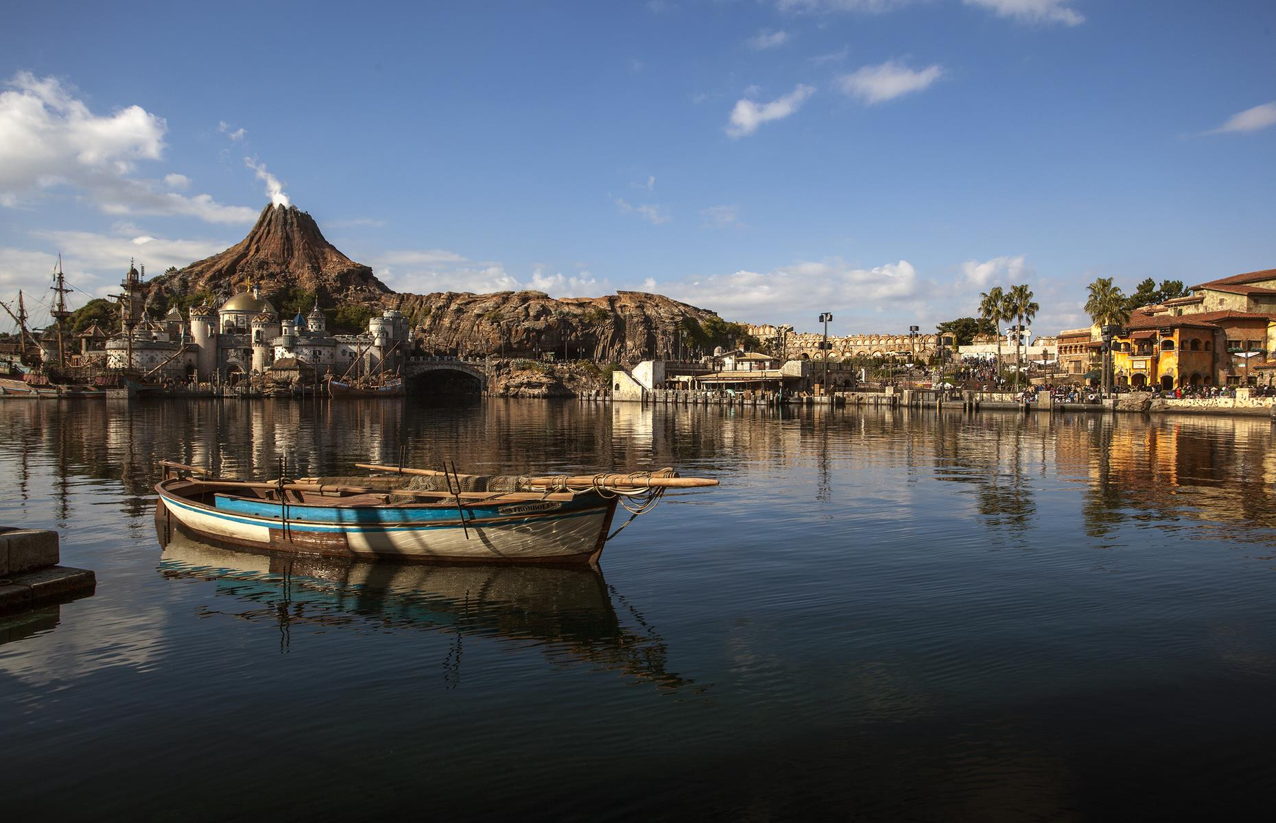 Slide 11 of 28: The project was soon forgotten in favor of WestCOT, Anaheim's answer to Florida's Epcot. However, this venture was also canceled due to financial limitations. Some elements of the fated Port Disney live on in Tokyo's DisneySea theme park (pictured), including the site's Mysterious Island with its imposing volcano as a backdrop.