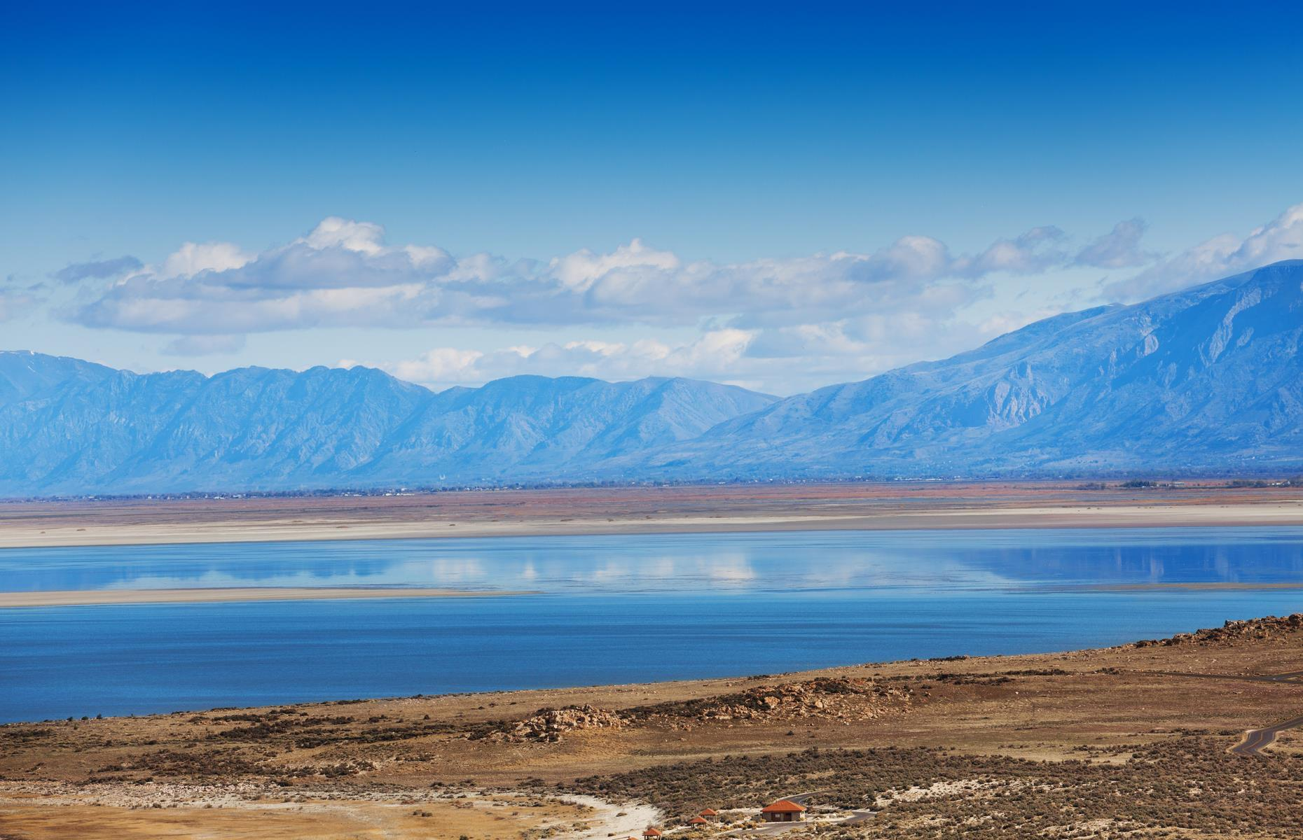 Slide 88 of 101: Wonderful views of the Great Salt Lake (pictured) reveal themselves along the road out west from Salt Lake City. The path from Utah's state capital to the little touristed city of Wendover involves around 120 miles (193km) on I-80 and about one hour 45 minutes on the road. Most scenic of all is an early stretch of the route that hugs the salt lake – there are designated viewing areas along the roadway here.