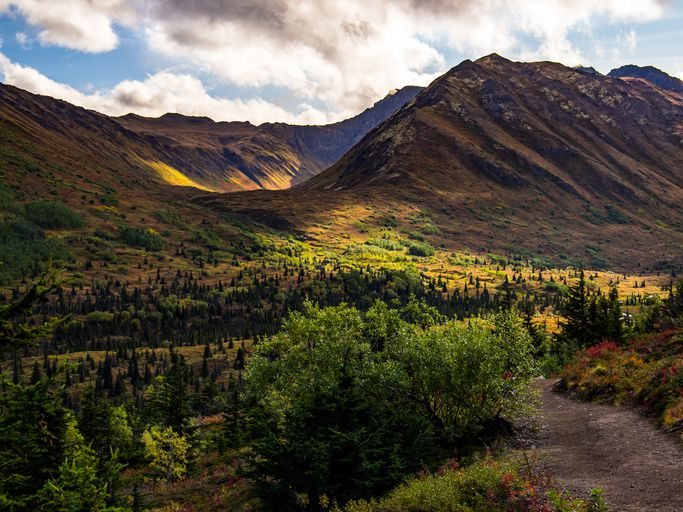Slide 3 of 53: Alaska is rife with outdoor paradises to explore, and Chugach State Park should be at the top of your list if you're in the area. Slightly east of Anchorage, this 495,000-acre park is one of the four largest state parks in the U.S.You can catch the Flattop Mountain shuttle from downtown Anchorage or use your own car to arrive at the park. Campgrounds, RV sites and public-use cabins are available in different locations around the park, which makes it easy to explore at your own pace. Chugach has plenty of wildlife, so keep your camera handy for marmots, lynx, bears, moose and more.