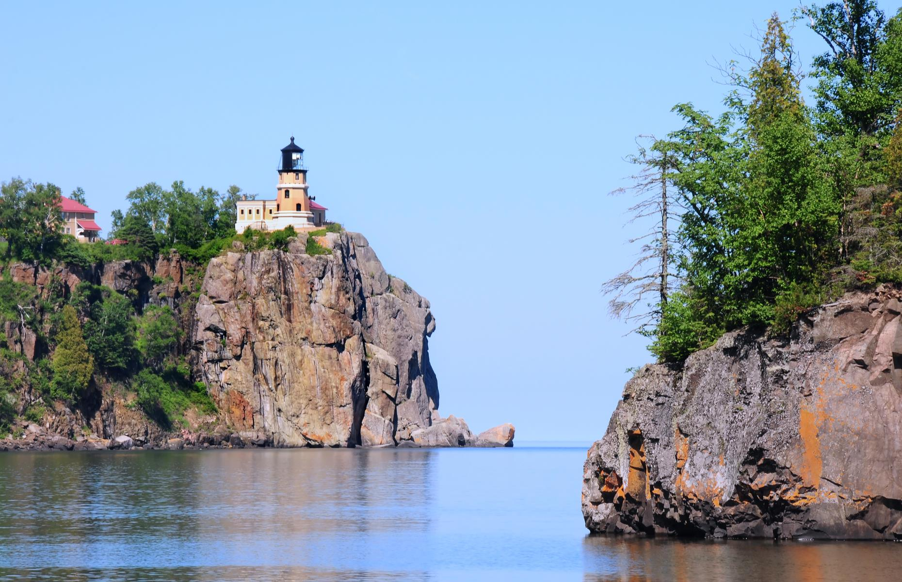 Slide 47 of 101: There are scenic spots aplenty along the North Shore, and the Split Rock Lighthouse State Park (pictured) particularly loves the camera. Aside from its majestic cliff-top lighthouse, the park has opportunities for wildlife viewing and around three miles of hiking trails along the lakeshore (check current park protocols here). There are typically plenty of great places to overnight in the Grand Marais area, but be sure to do your research before you travel.