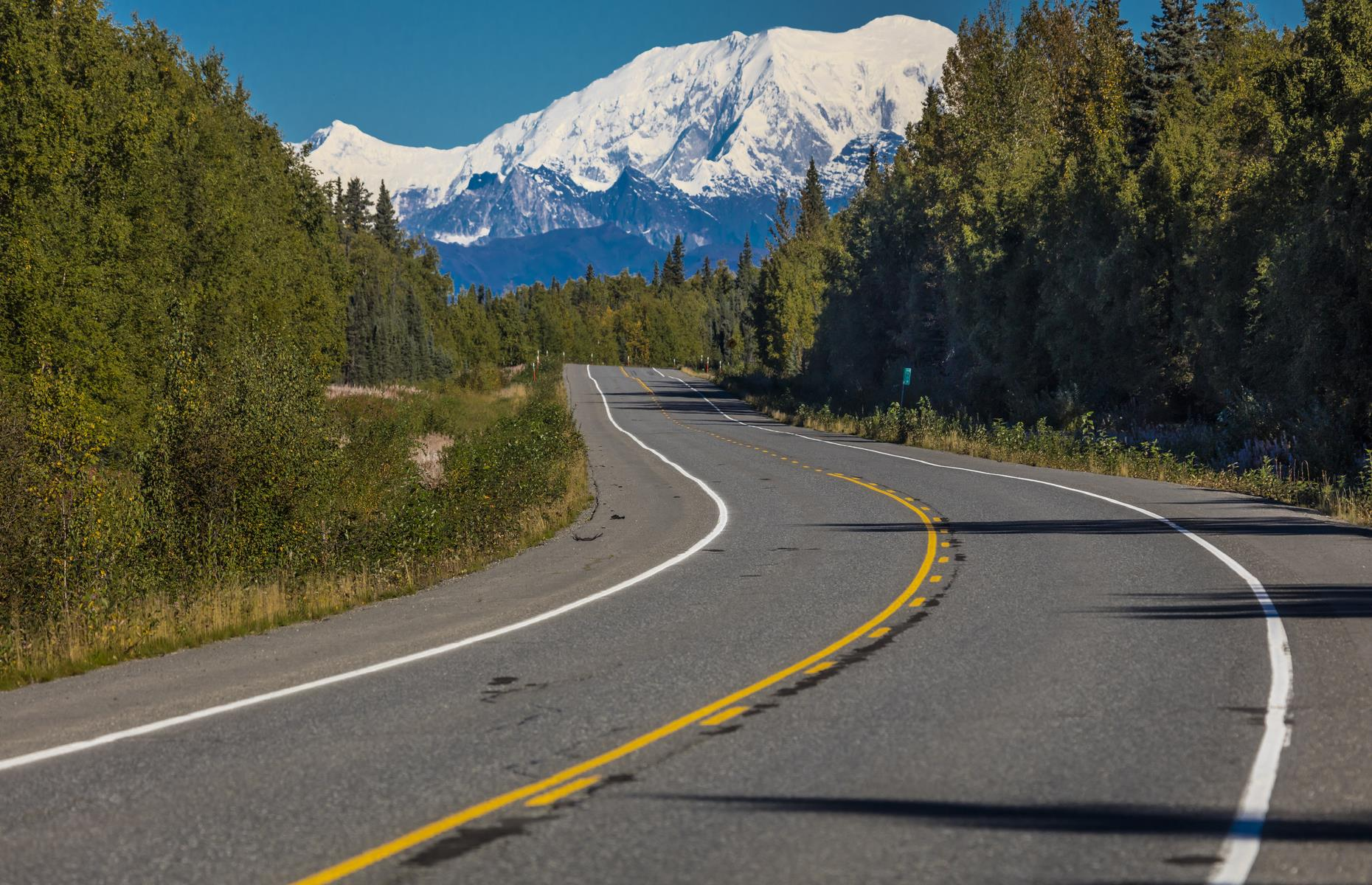 Slide 4 of 101: Due to its sheer size, Alaska doesn't lend itself well to quick weekend jaunts, but the 112-mile (180km) journey south from Fairbanks to Healy leads right to the gateway of Denali National Park. The legendary George Parks Highway is a destination in itself – all snow-crowned peaks and wide open roads. The journey takes around two hours at least, and in Healy, there are a handful of RV parks, hotels and restaurants. At present, be sure to check the opening status of food outlets and reserve accommodation before leaving.