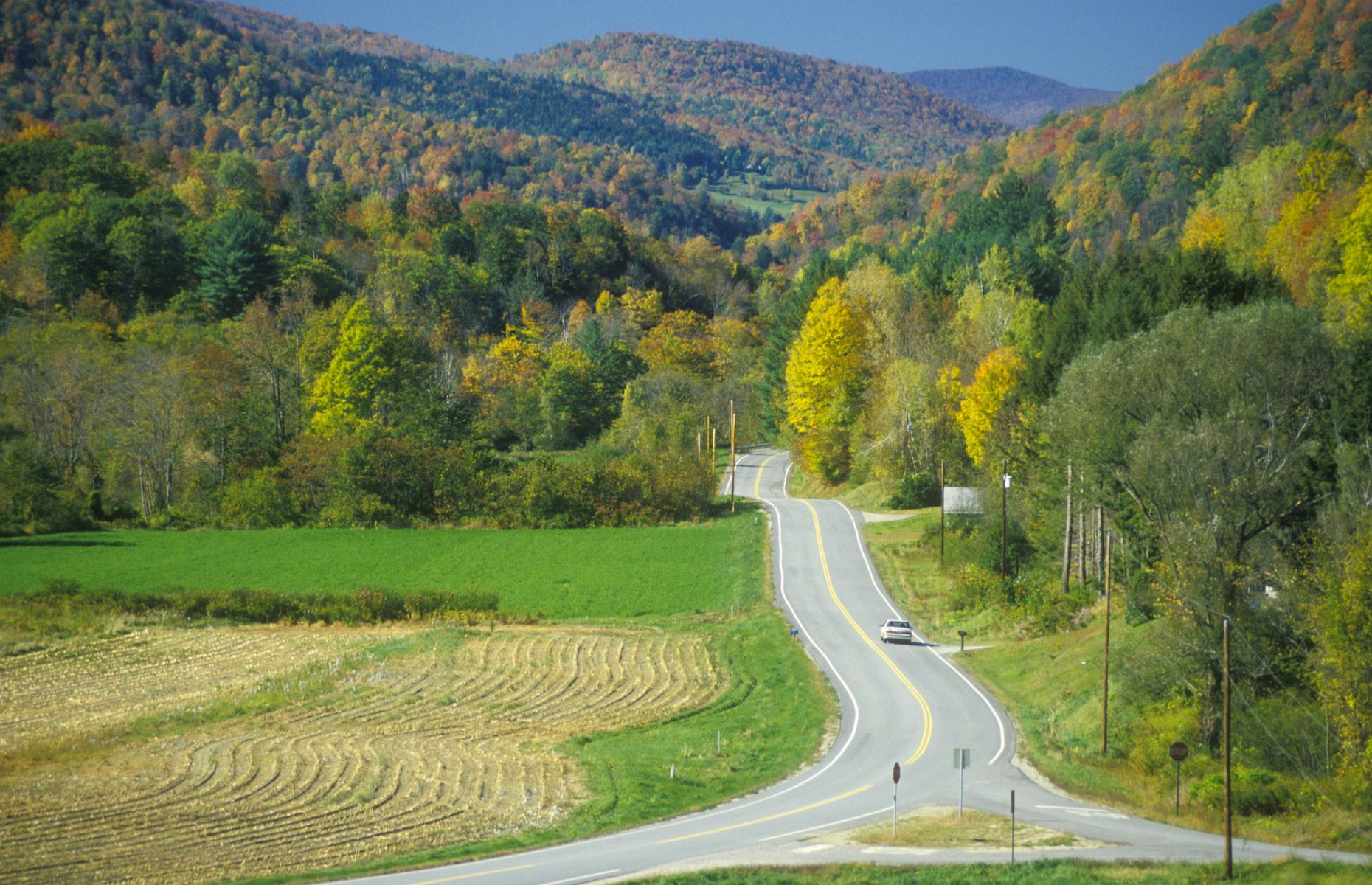 Slide 90 of 101: Following Vermont's Scenic Route 100 Byway (pictured), this New England road trip winds from the northern town of Stowe to Weston in Windsor County. While each town has charms aplenty, the road itself steals the show. Even more impressive in the fall, it clings to the eastern edge of the Green Mountains. Without any pit stops, the 100-mile (161km) drive takes under two hours 30 minutes. Discover the most beautiful scenic byway in every state.