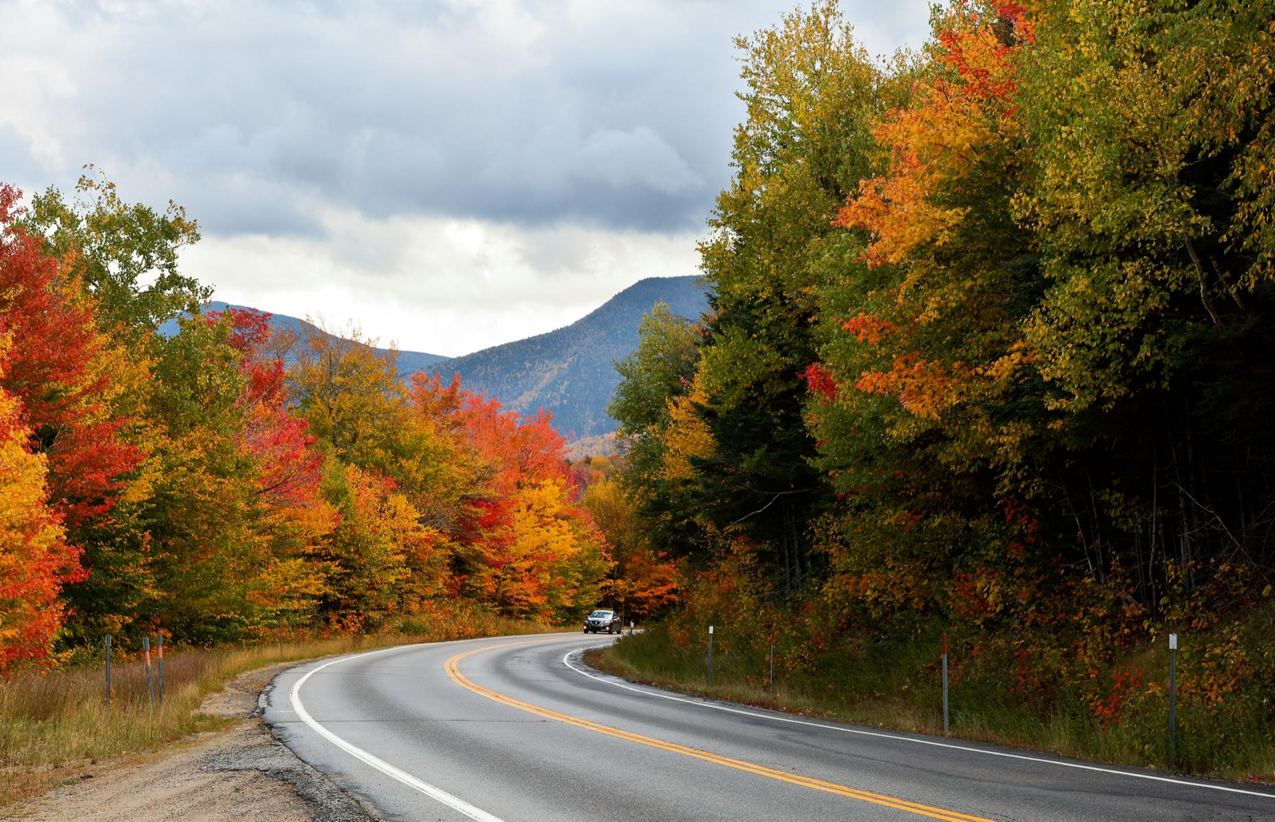 Slide 58 of 101: Best traveled in the fall, this road-trip route takes the long way from the Strafford County city of Dover to the White Mountain town of Lincoln. The first stretch of the journey pushes north on NH-16 to reach Conway, a small town close to Echo Lake State Park (this park now requires an advanced day-use reservation). From Conway, the driver is rewarded with stunning views as they travel on the famed Kancamagus Highway (pictured) through dense White Mountain forest to reach Lincoln.