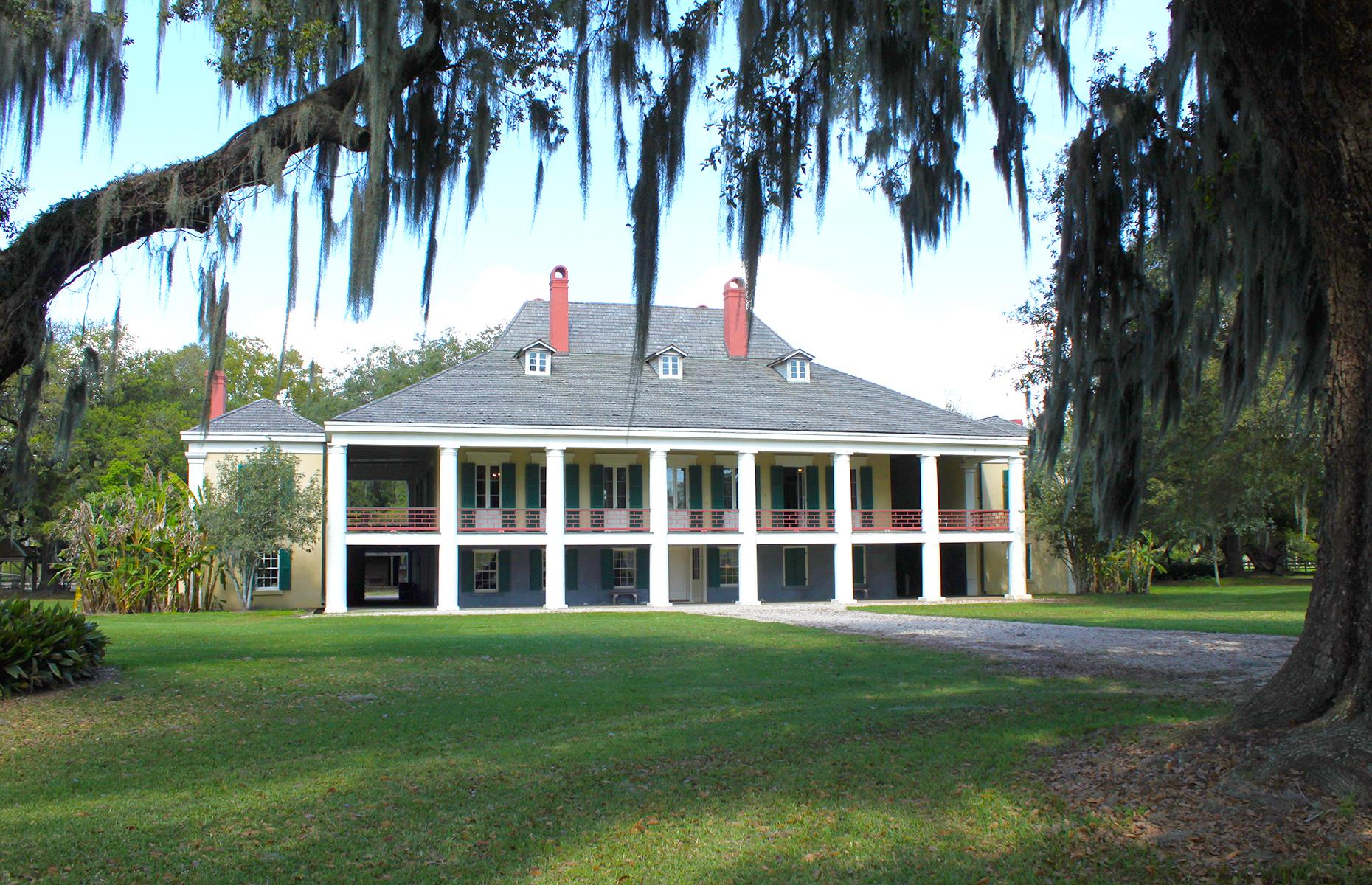 Slide 37 of 101: After the sights and sounds of the Big Easy, popular stops along this route include the Destrehan Plantation (pictured), thought to be the oldest plantation home in the Lower Mississippi Valley. Exhibits at this site include the quarters of the enslaved peoples who lived here, and guided tours typically run most days. Also en routeis the poignant River Road African American Museum (you'll need to book a tour online or via email), before the road eventually spills into thecity of Baton Rouge.