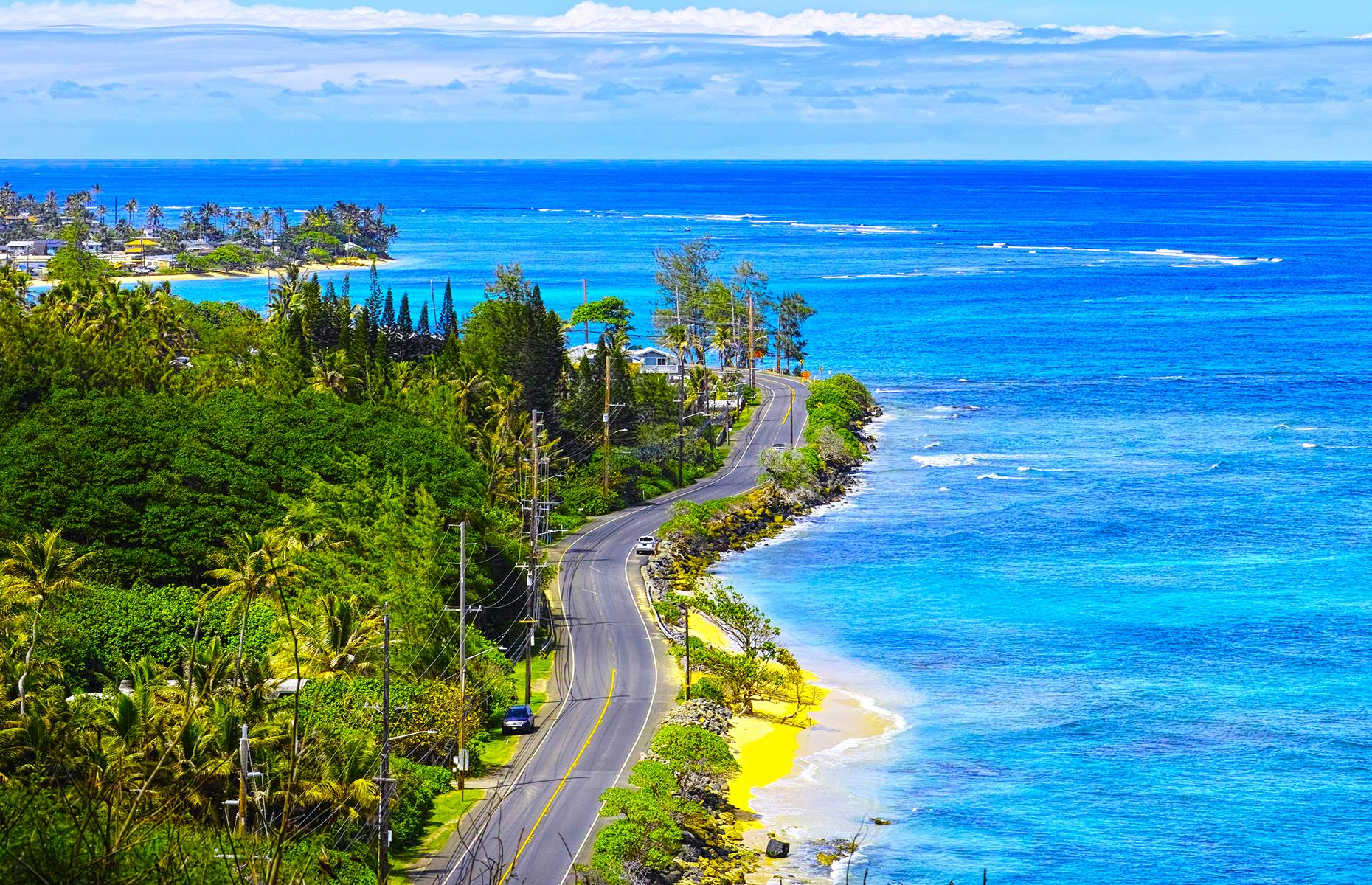 Slide 22 of 101: When it comes to planning road trips, travelers often eschew Hawaii (not least because it's the only state you can't drive to). But there are still plenty of stunning routes to be enjoyed. A favorite is the Kamehameha Highway (pictured). This route takes adventurous road-trippers from buzzing Honolulu to the more remote beaches and towns of Hawaii's North Shore. On this drive, the city of Pūpūkea is around 45 miles from the capital, and the trip involves just over an hour of driving time.