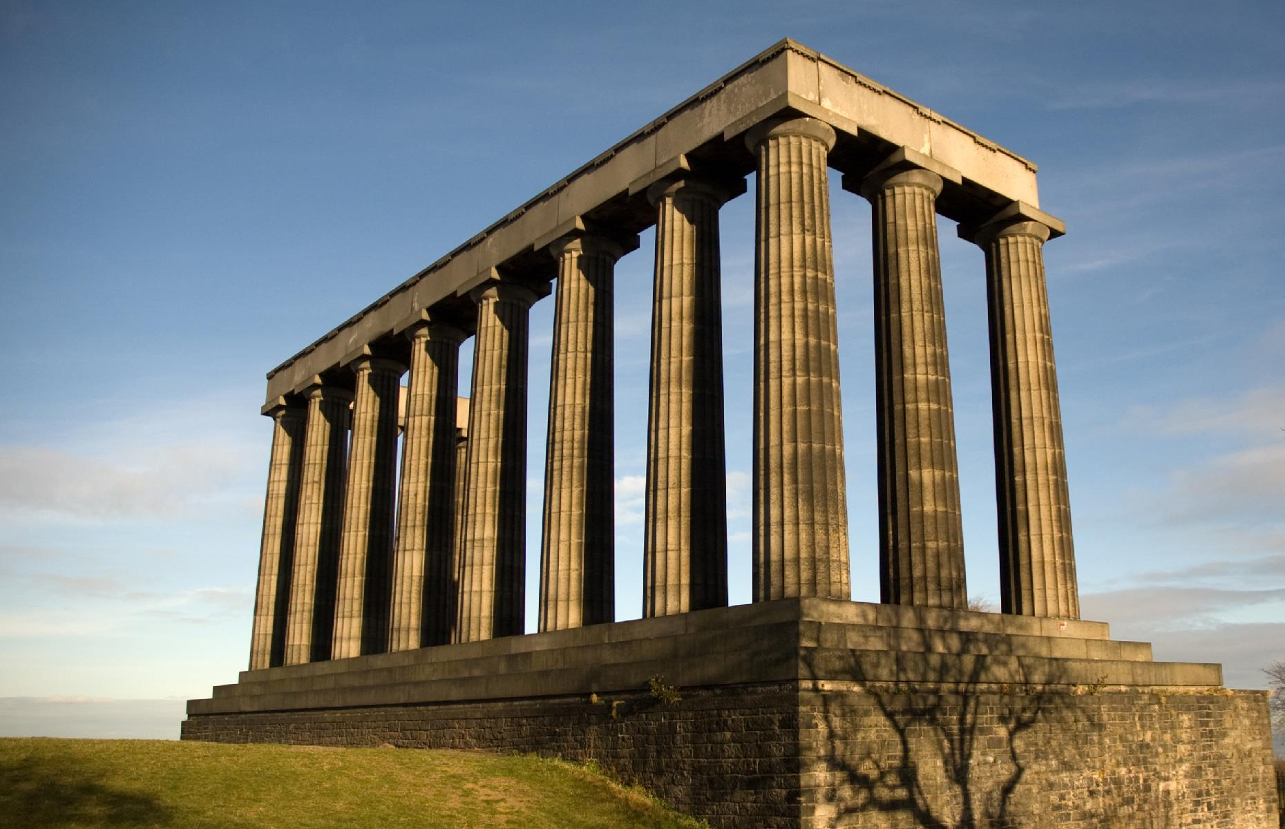 Slide 7 of 31: However, the project planners failed to collect enough money to complete the monument and tools were downed by 1829. When work finished, only 12 columns – the 12 still standing sentry on Calton Hill – had been erected. Over the decades, many ideas for how to use and/or complete the monument have been floated, but so far nothing has stuck. This little slice of Greece remains today. Take a look at the famous landmarks that were almost destroyed.