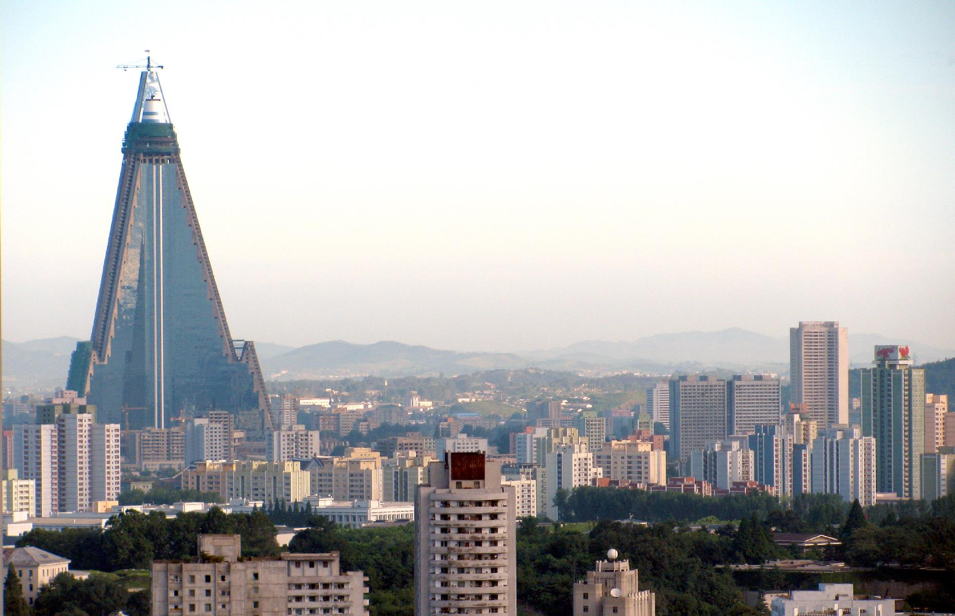 "Slide 8 of 31: Standing head and shoulders above the rest of Pyongyang's skyscrapers, this gigantic pyramidal structure has been a work in progress for decades. Ground first broke in 1987 and the building was intended to be a 3,000-room hotel with bells and whistles such as revolving restaurants. However, its construction has been plagued with issues – so much so that the landmark has been nicknamed the ""Hotel of Doom""."