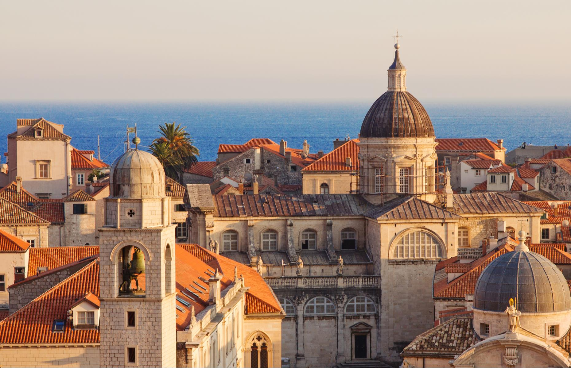 Slide 20 of 30: From its apricot and honey-hued rooftops to its wide, marble roads, Dubrovnik's 13th-century Old Town is almost too pretty to be true. It's encased by thick stone walls that give clear views in every direction. If that wasn't enough, it looms over the Adriatic Sea, with views of the sapphire water dotted with verdant islands.