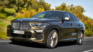 a car driving on a road: 2020 BMW X6