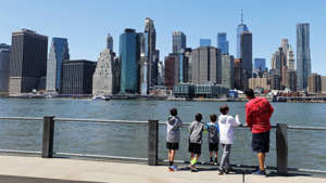 a group of people standing next to a body of water in a city: One-third of Bronx test subjects have coronavirus antibodies