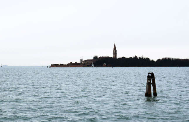 Slide 4 of 35: This isle in the Venetian Lagoon has a haunting history. It's also known as Plague Island because in the late 1700s and early 1800s it was used to quarantine plague victims. Numerous islands in the Venetian Lagoon were used for this purpose at this time, and Poveglia reportedly held hundreds of thousands of sufferers. Legend has it the isle is still haunted by the deceased.