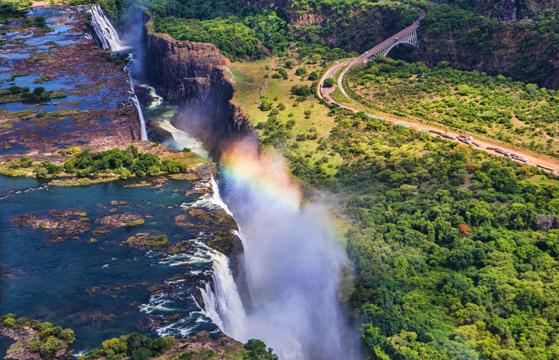 Slide 7 of 31: A mighty sight on the mighty Zambezi River, Victoria Falls is more than 5,500 feet (1,700m) wide and has a sheer drop of 355 feet (108m). In other words, it's an incredible sight – and has a roar to match. The thundering sound as the water crashes down the near-vertical drop is loud and creates such a veil of mist that the Kalolo-Lozi people named the falls Mosi-oa-Tunya, or 'The Smoke That Thunders'.